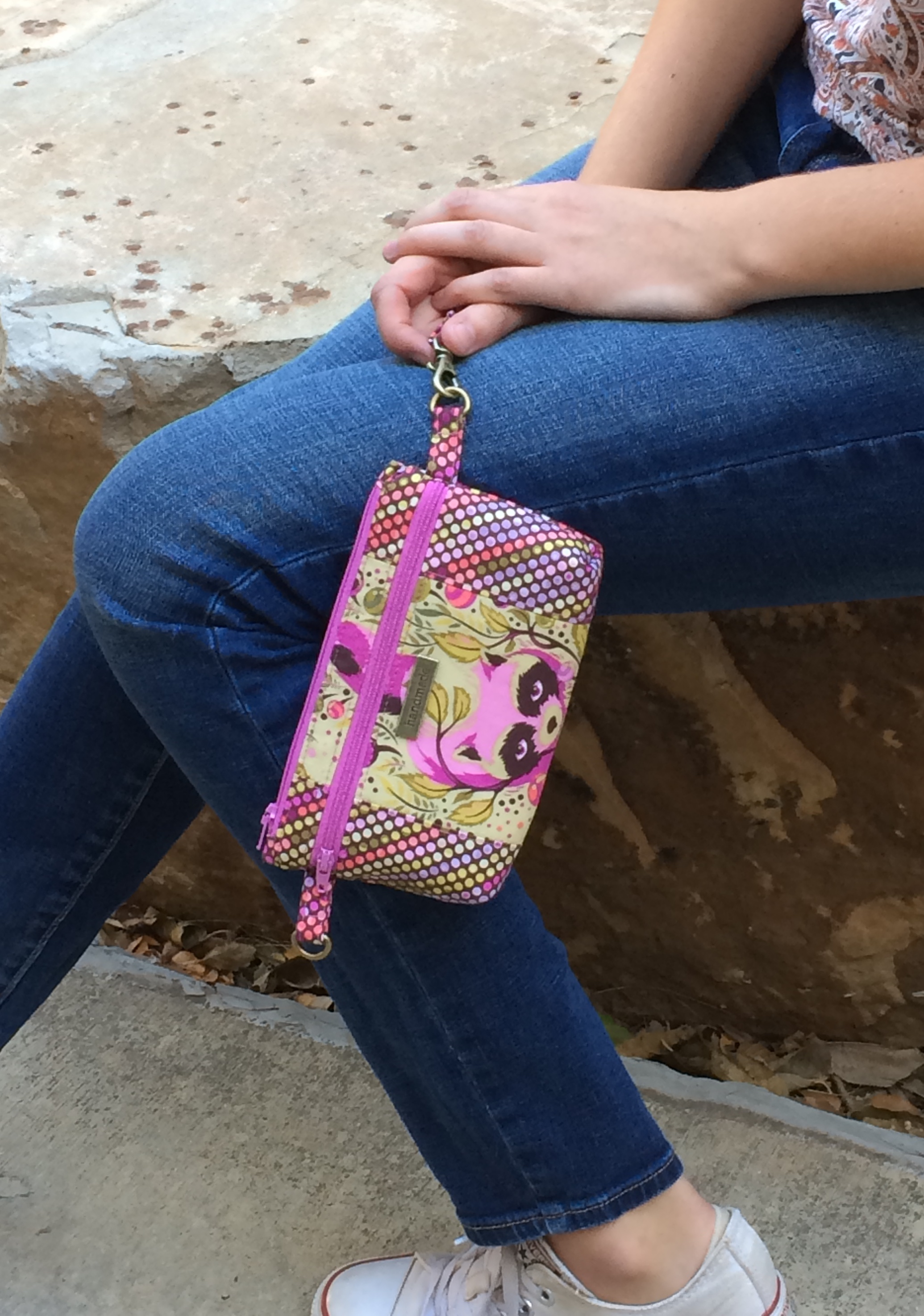 "If you are familiar with the Lindsay Wristlet, you may notice that this one has something extra to it. More on this ""something extra"" later this week!"