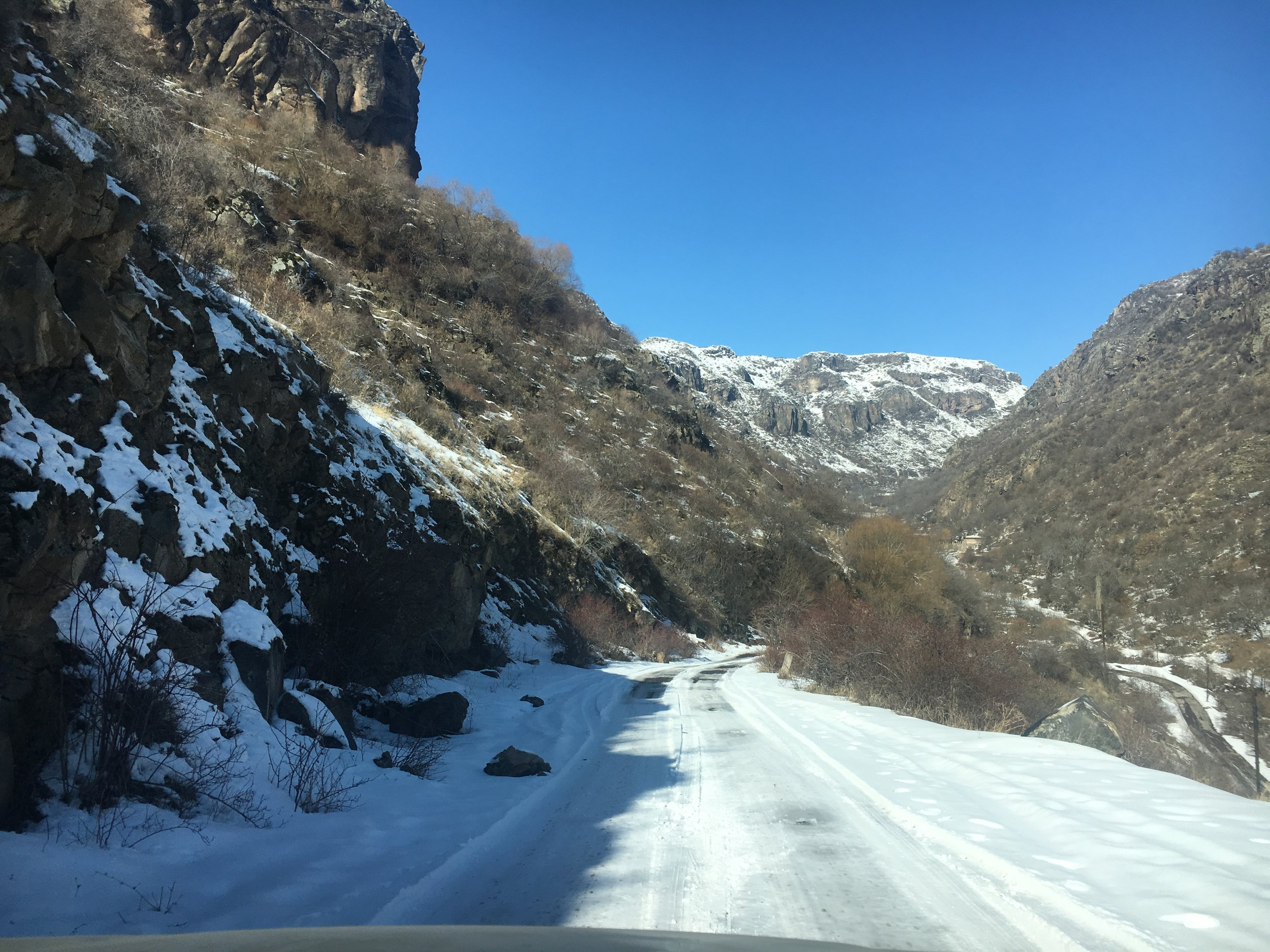 Driving down steep icy mountain roads in Aragatsotn Province on the way towards Amberd Fortress in the dead of winter.