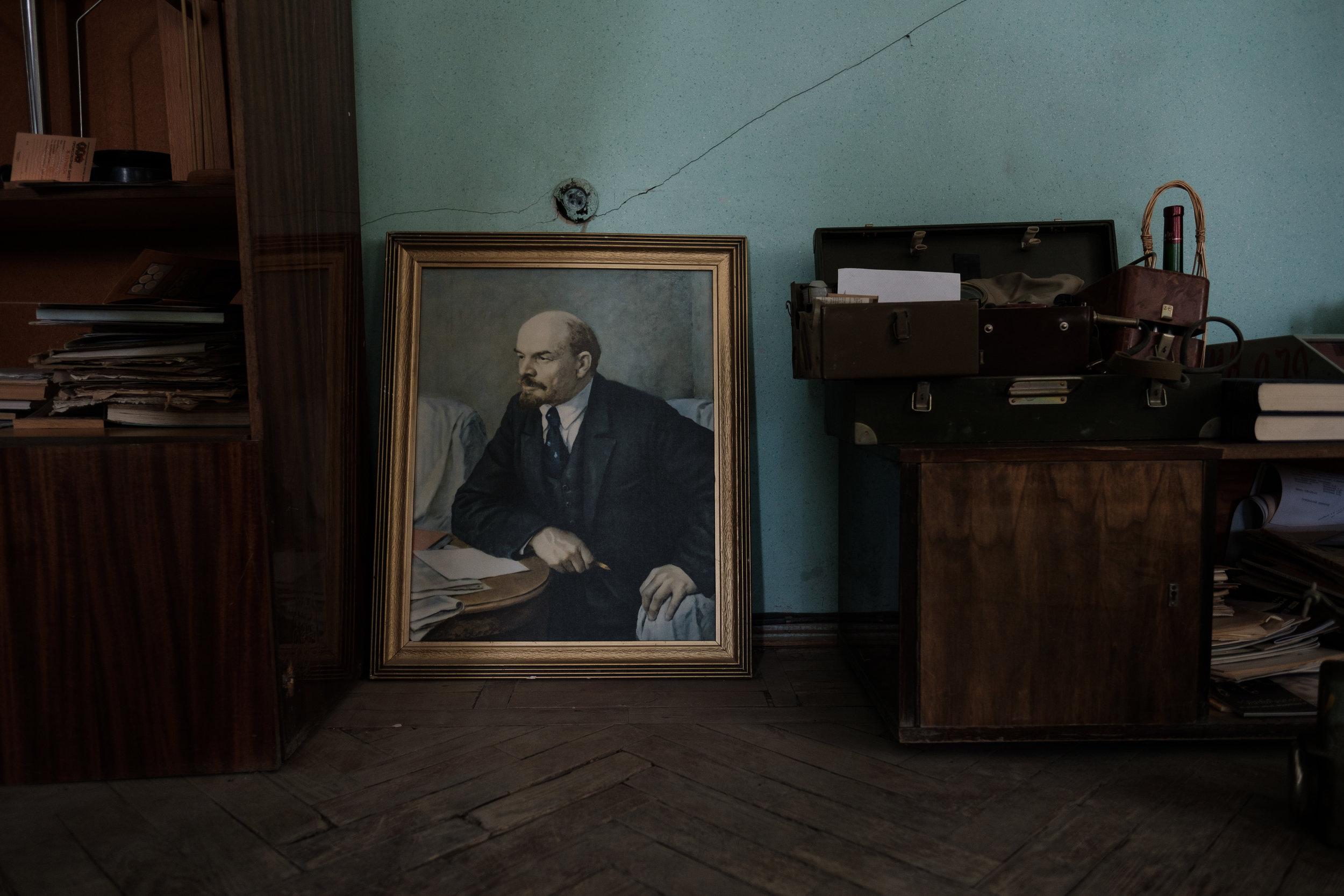 Portrait of Lenin and other Soviet memorabilia.