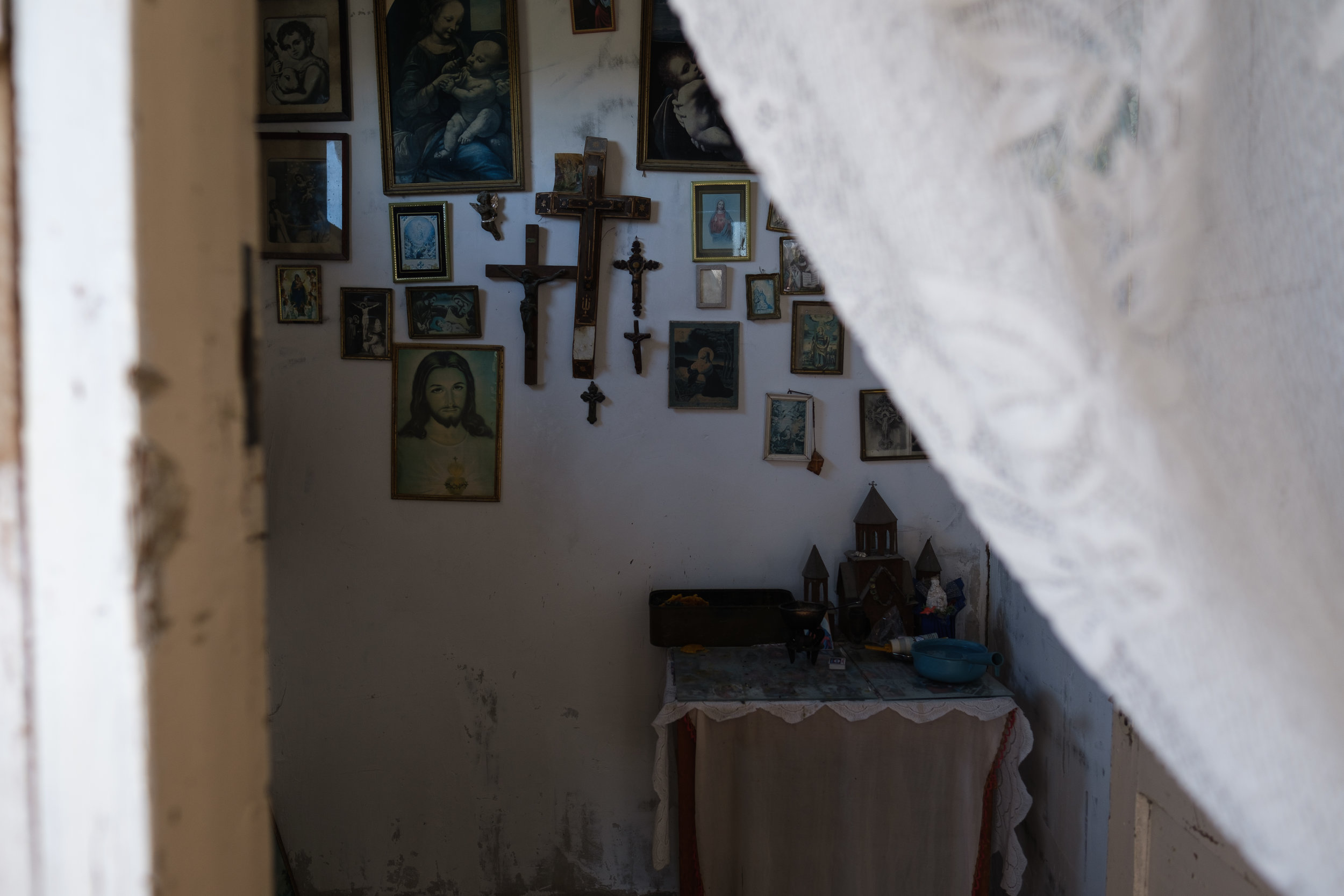 Religion is an important part of life for most Armenians including Svetlana. Walking into her home a prayer room full of crosses caught my eye.