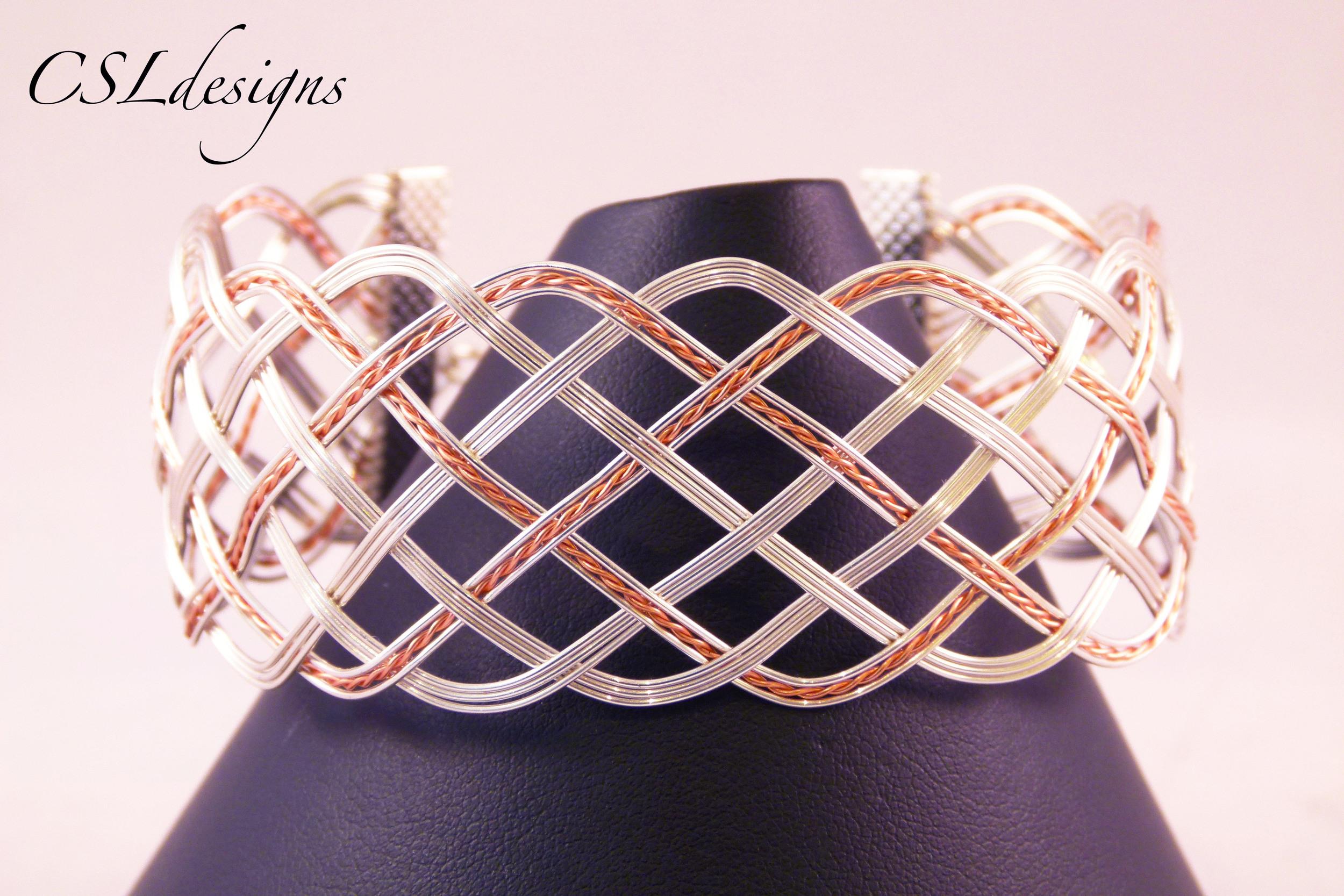 Open wirewoven silver copper bracelet front close.jpg
