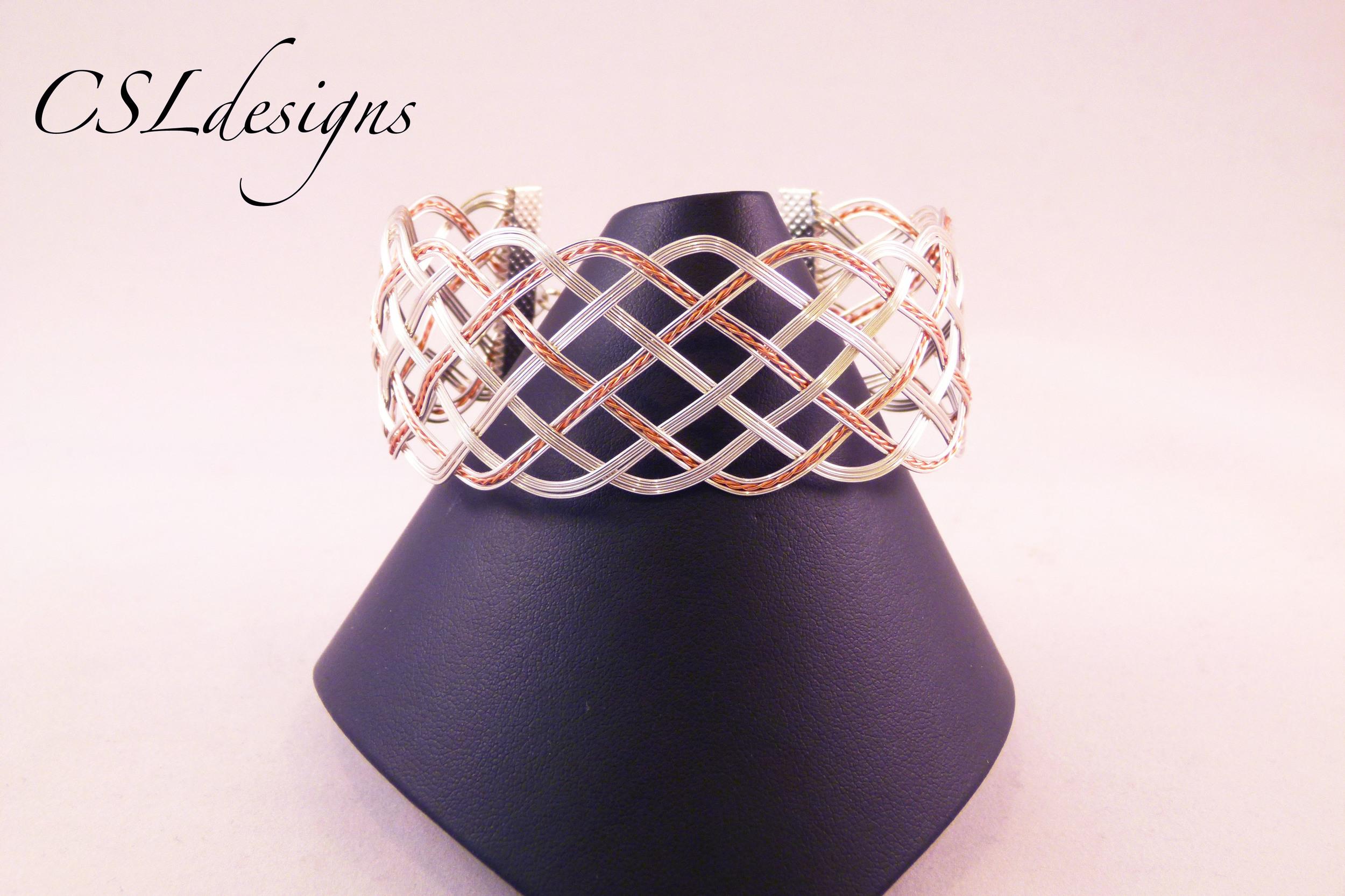 Open wirewoven silver copper bracelet front full.jpg