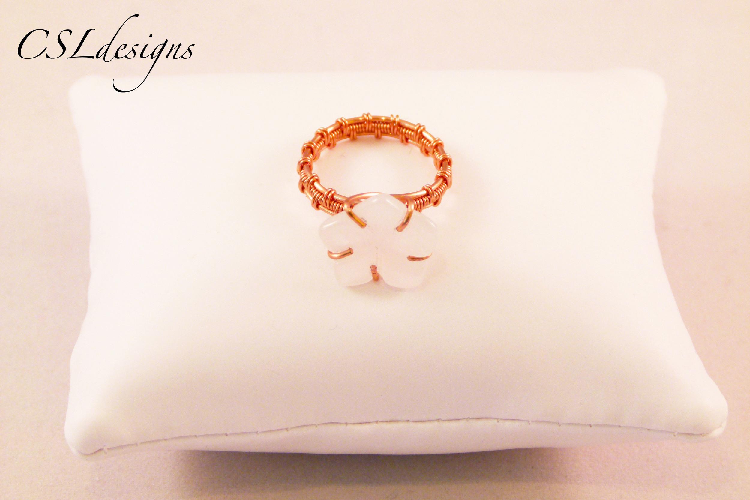 Copper wirework flower ring front pillow.jpg