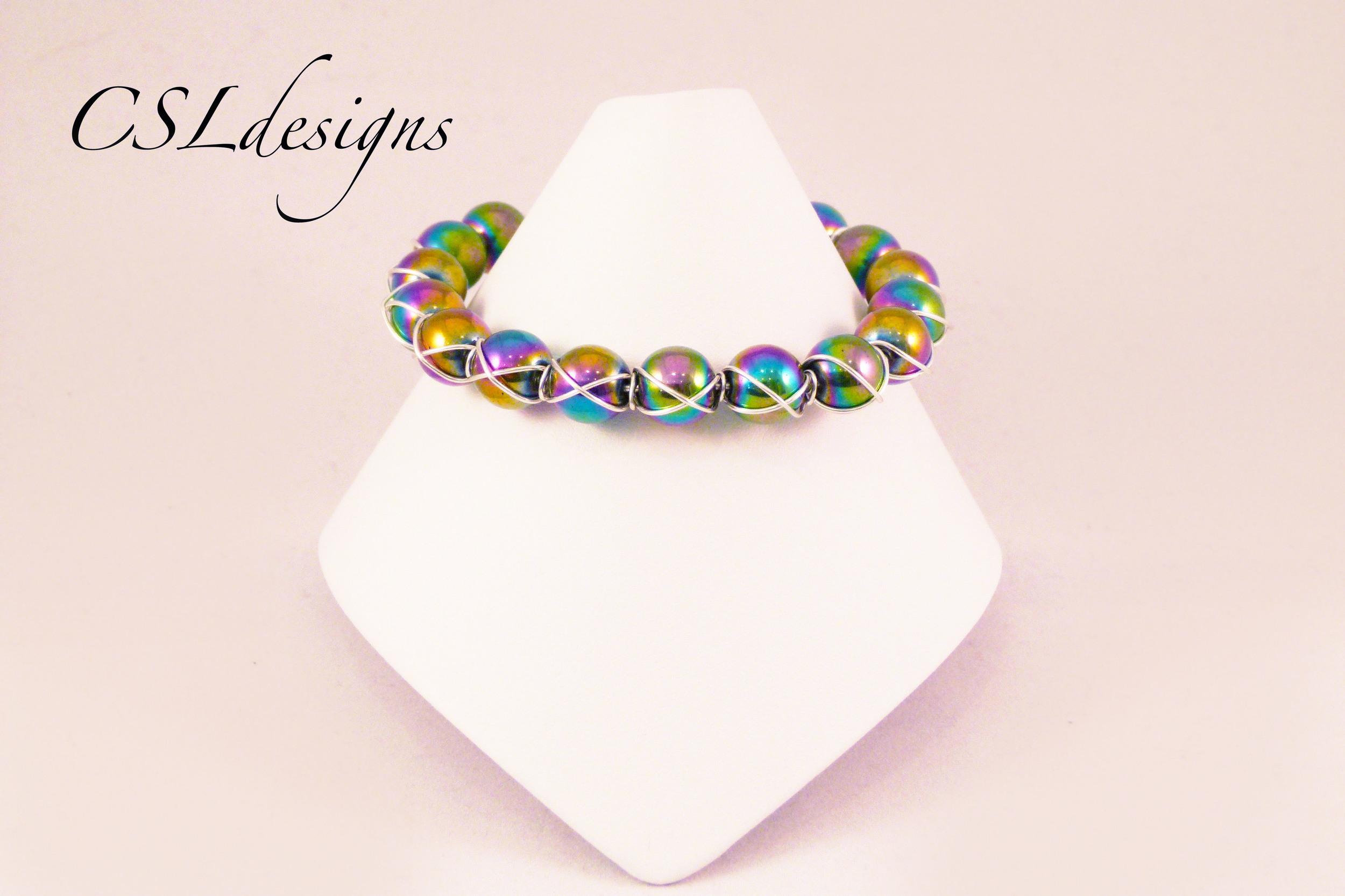 Cross wire wrapped rainbow bracelet front full.jpg