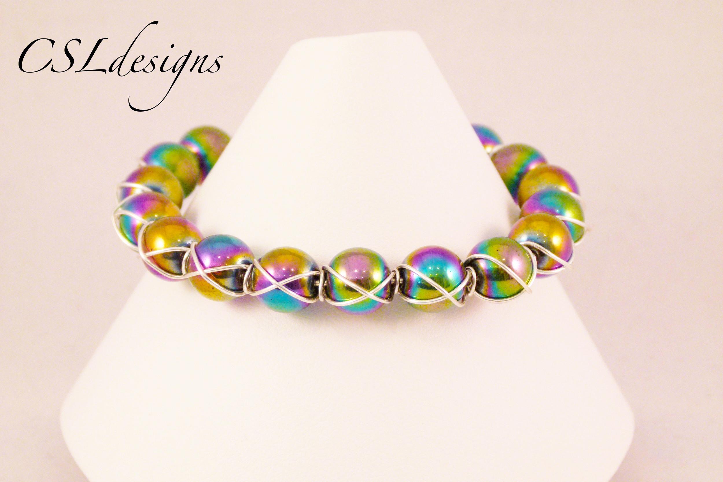 Cross wire wrapped rainbow bracelet front close.jpg
