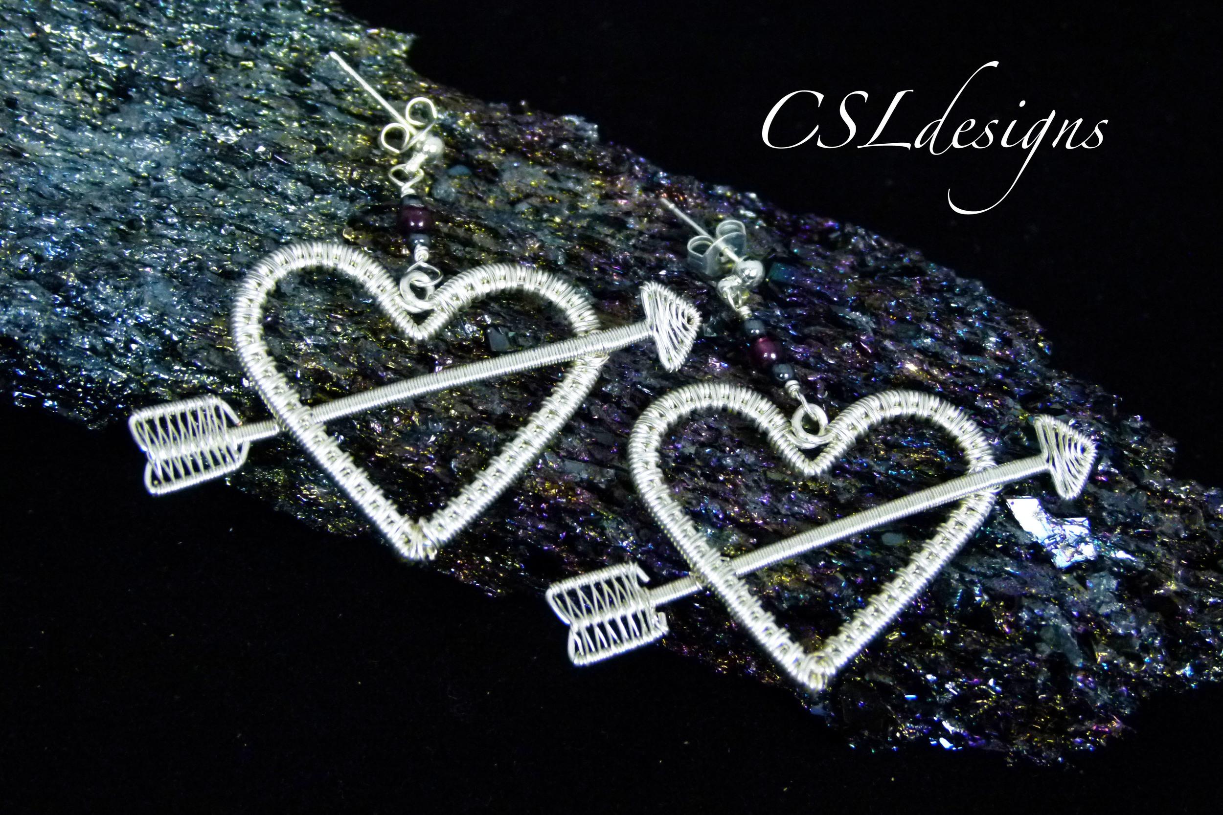 Wirework valentines set earrings lying down.jpg