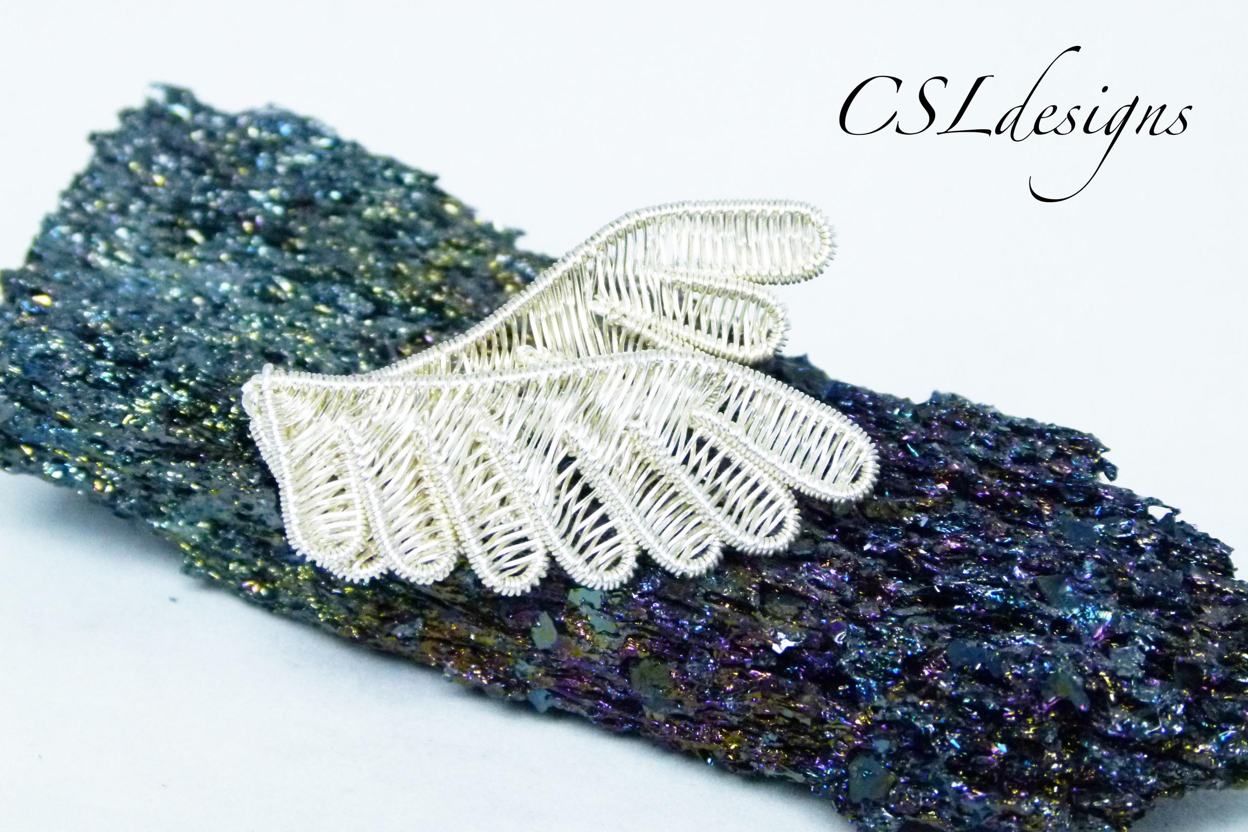 Wirework wings brooch front.jpg