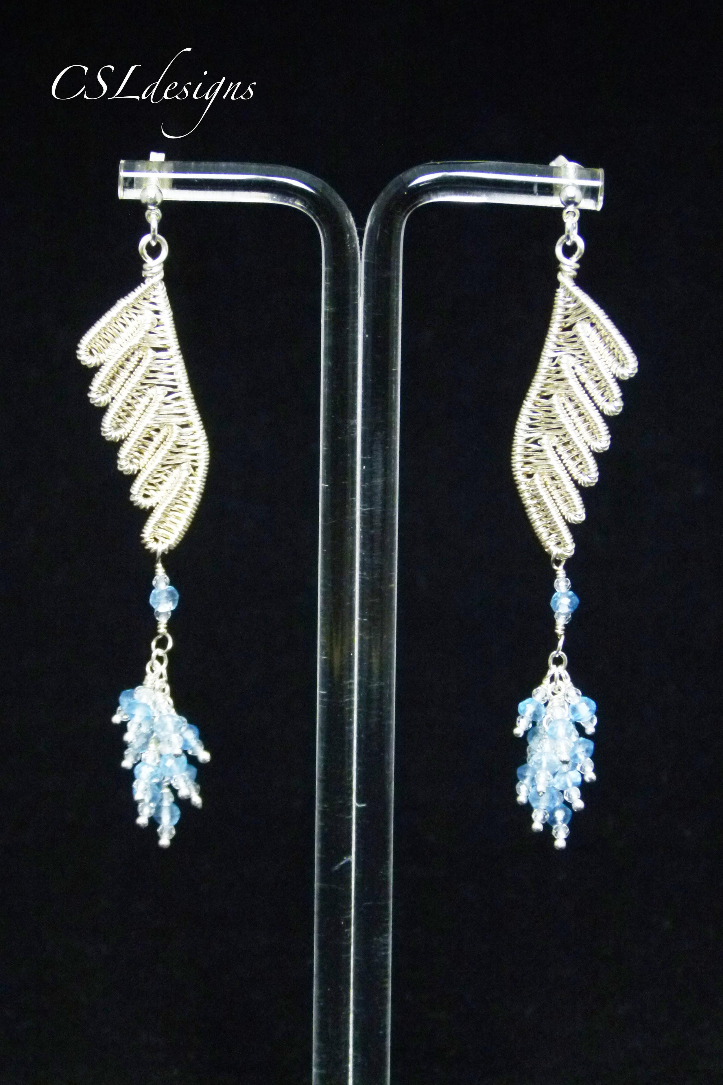 Wirework wings earrings stand.jpg