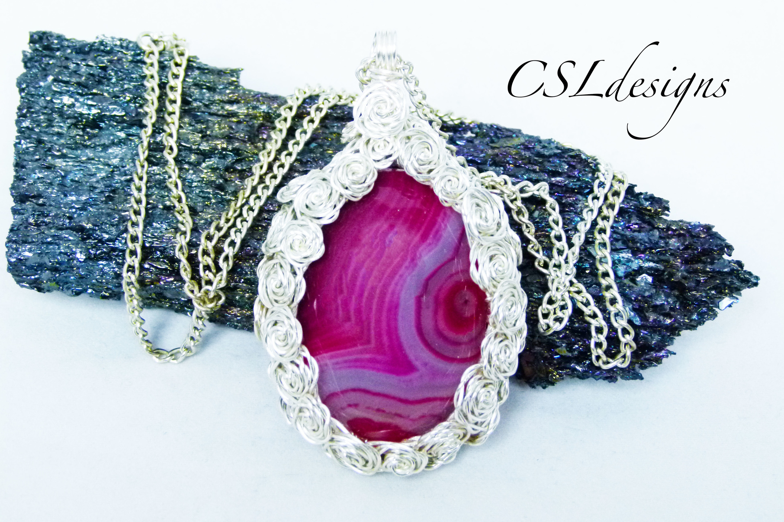 Rose covered wire wrapped cabochon pink stone.jpg