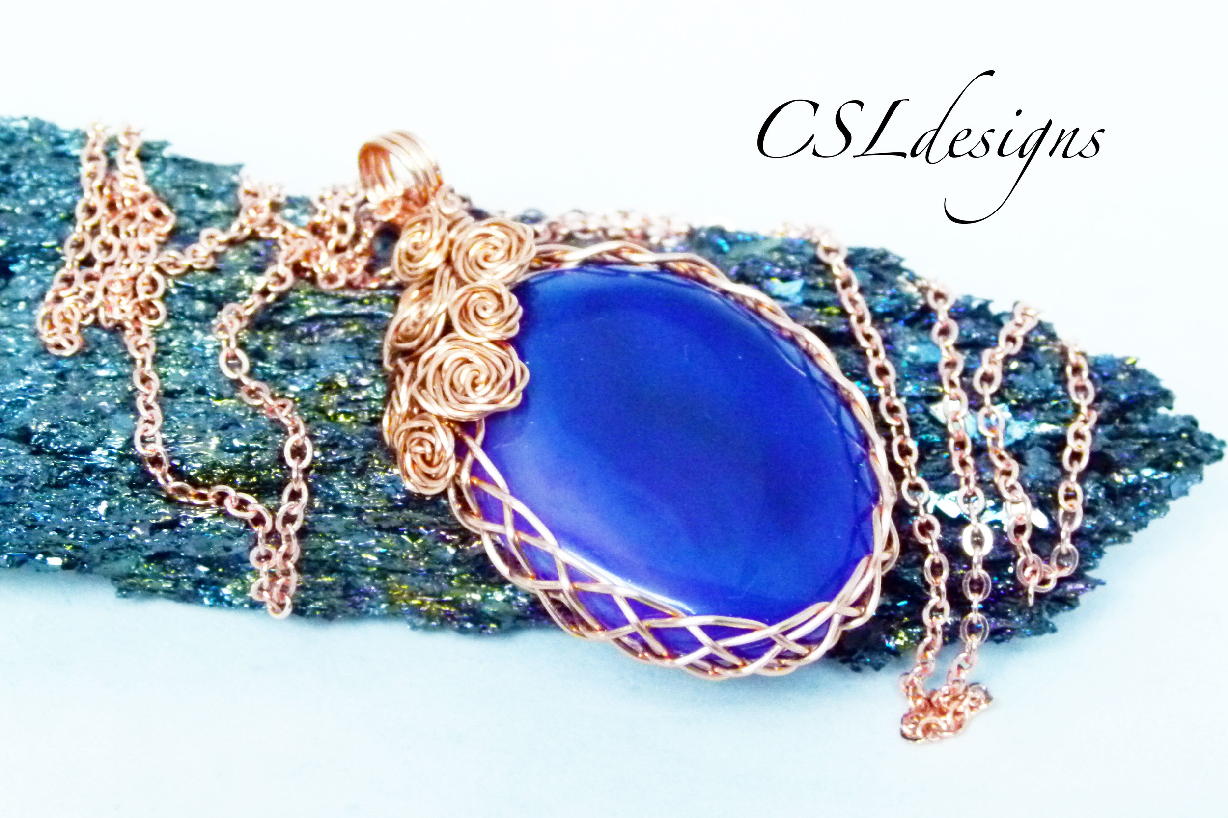 Rose covered wire wrapped cabochon purple stone side.jpg