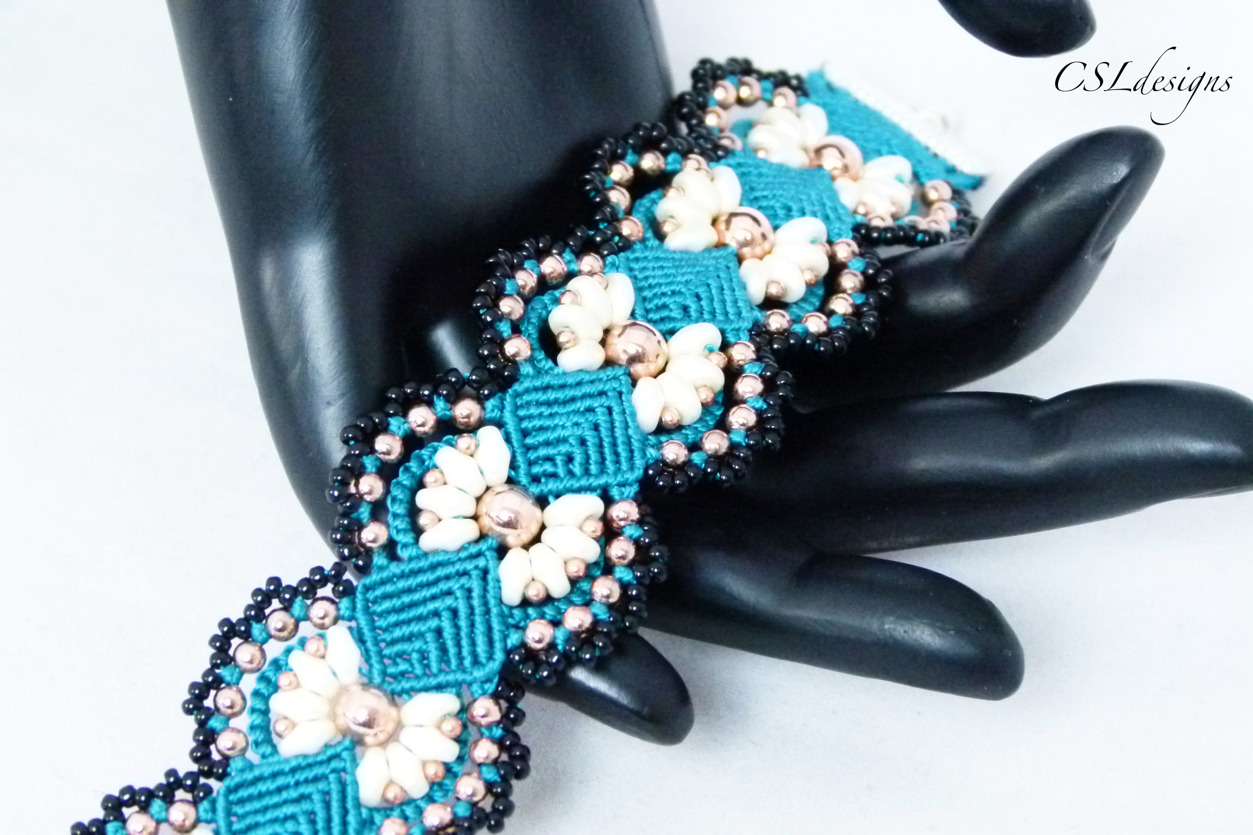 Daisy micro macrame bracelet hand close.jpg