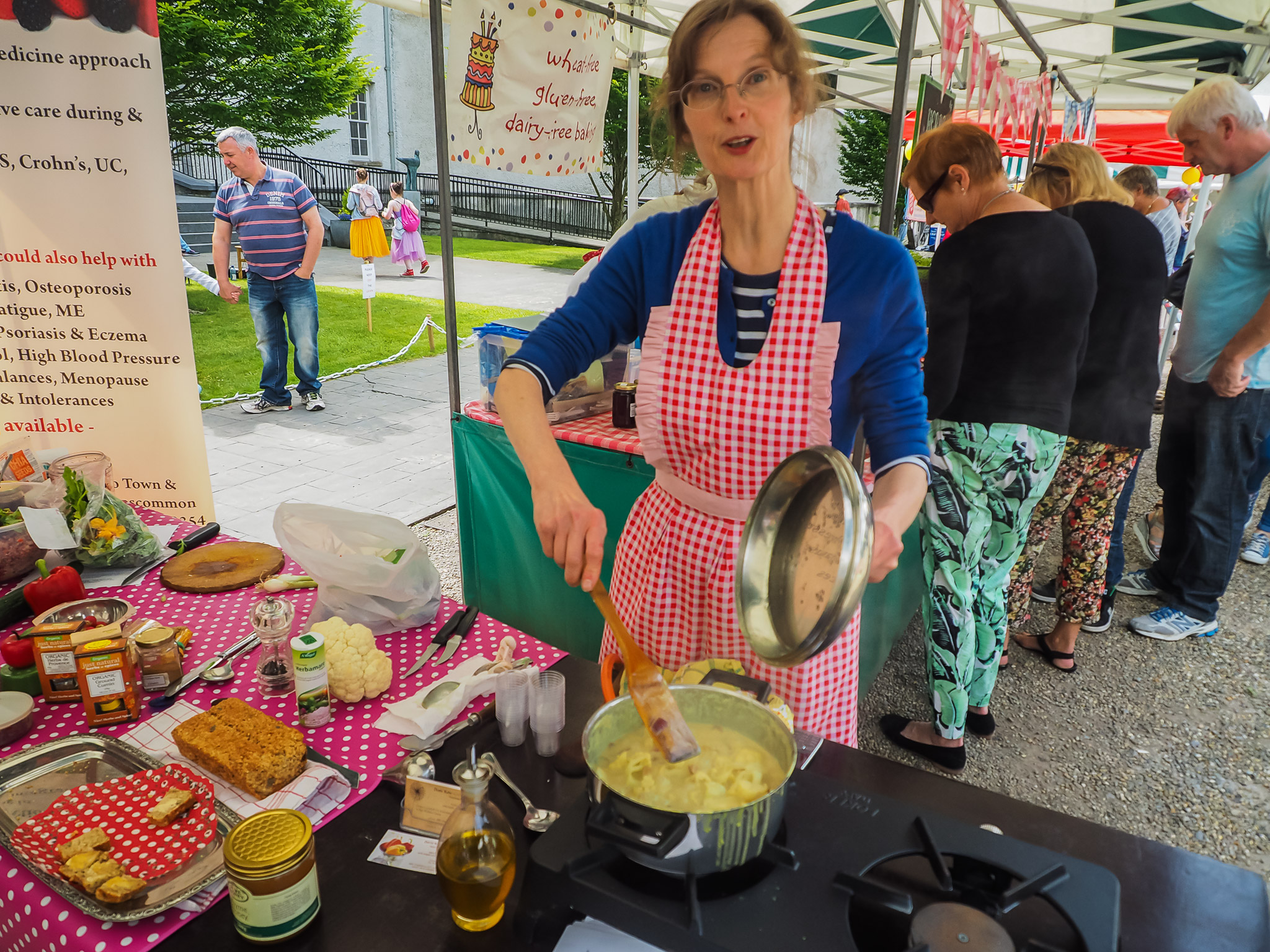 Doris from Good Health Clinic Cootehall giving a cookery demonstration, Boyle Courtyard Market, County Roscommon.