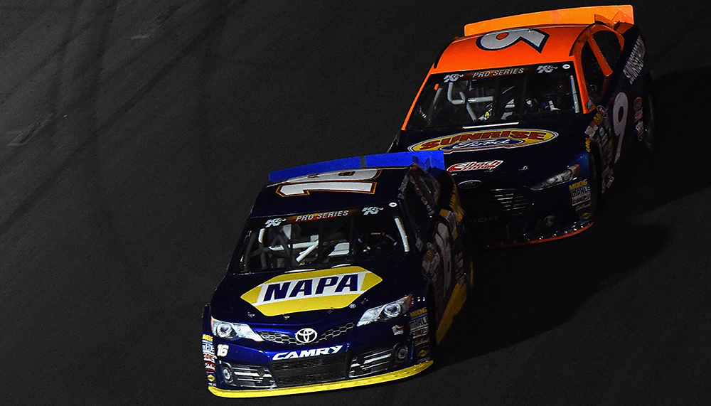 Todd Gilliland (16) passed Todd Partridge (9) for the win Saturday at Kern County Raceway Park