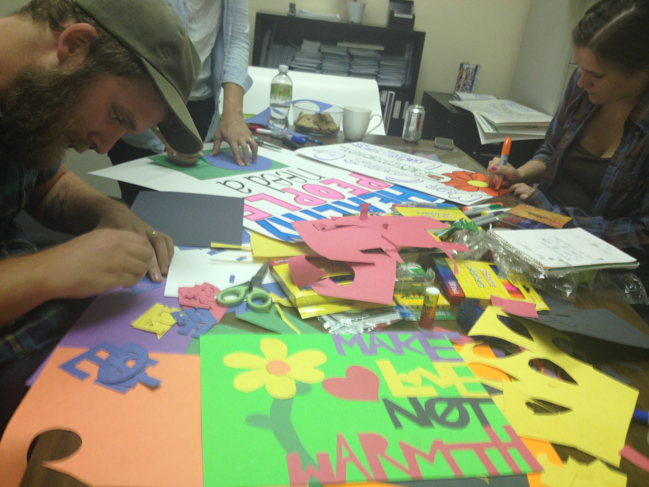 Bewilderers hard at work making signs the day before the event