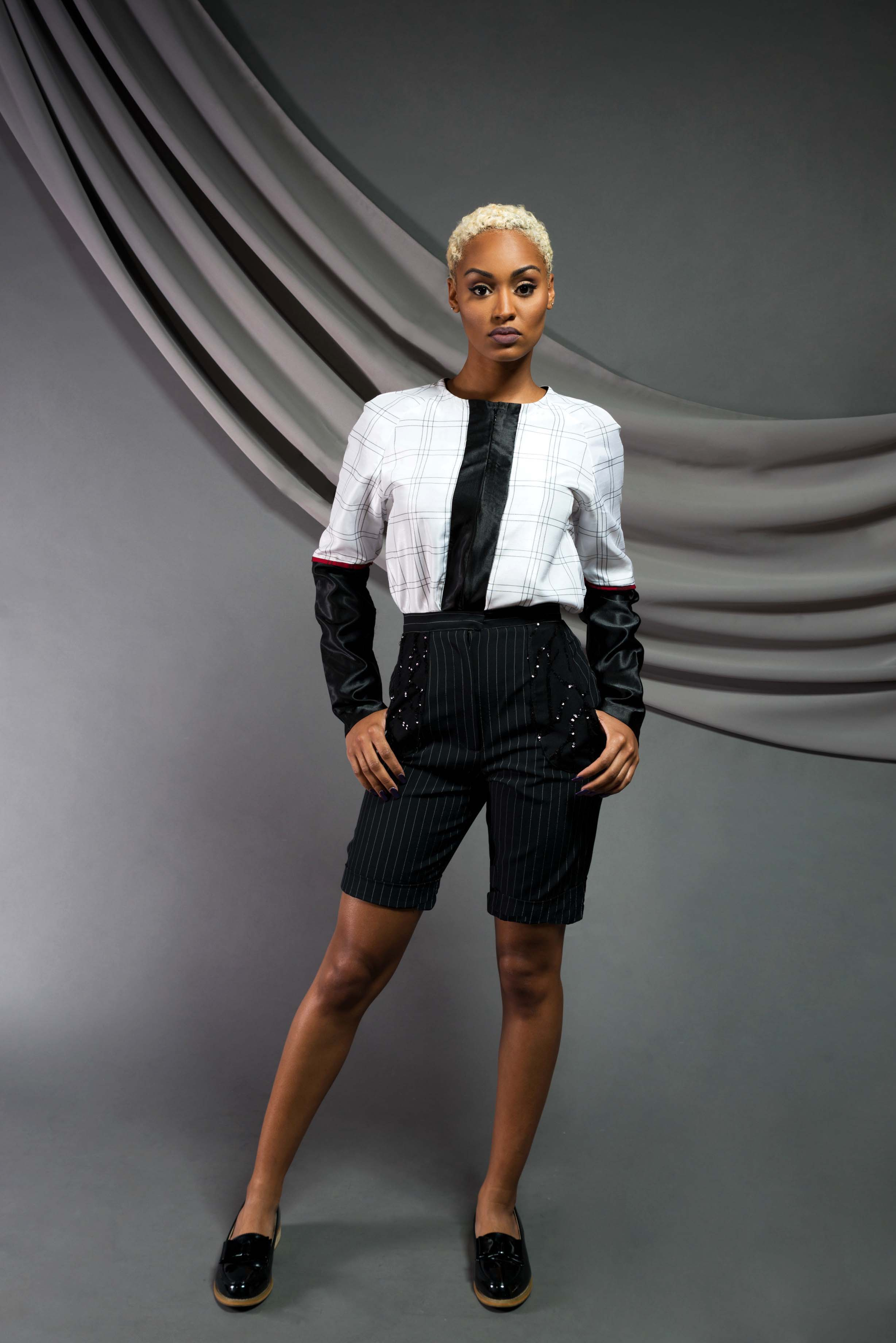 Long-sleeve Poker blouse:  Satin shantung,dupioni silk, viscose   Sequin Bermuda Shorts:  Wool suits, sequin mesh