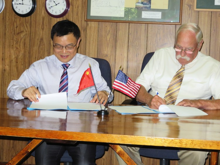 Both school principals signing the partnership agreement for one of our partner schools.