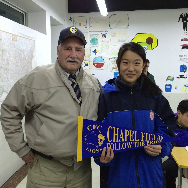 The president of Chapel Field meets a student from one of our partner schools.