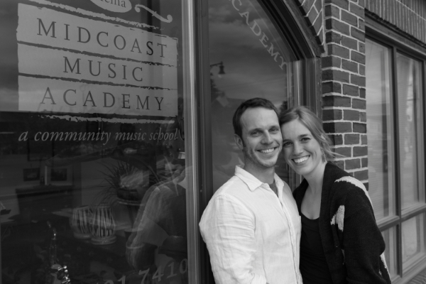 Tom and his wife Anne, Secretary of the Board, in front of the Academy on its opening day.