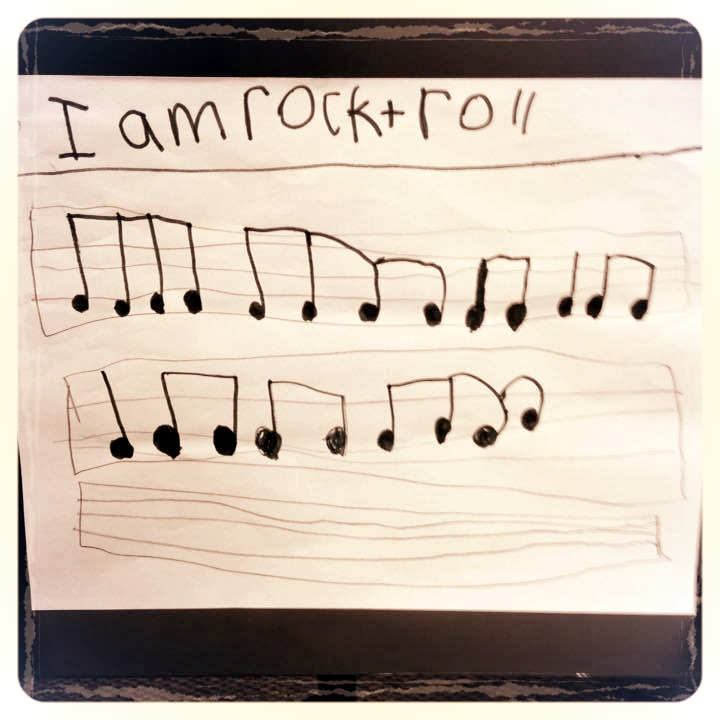 An 8-year-old drum student learns he is a rocker at heart. Photo credit: Kristen Page Baker