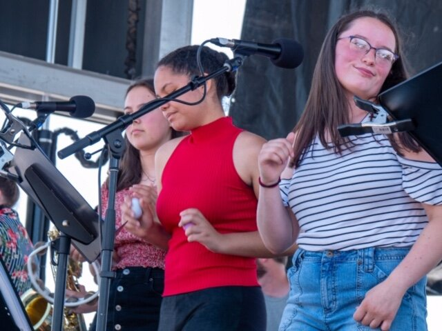 MCMA students Aili, Heather, and Alydia singing on the Main Stage at the North Atlantic Blues Festival.  Photo credit: Pete Kalajian