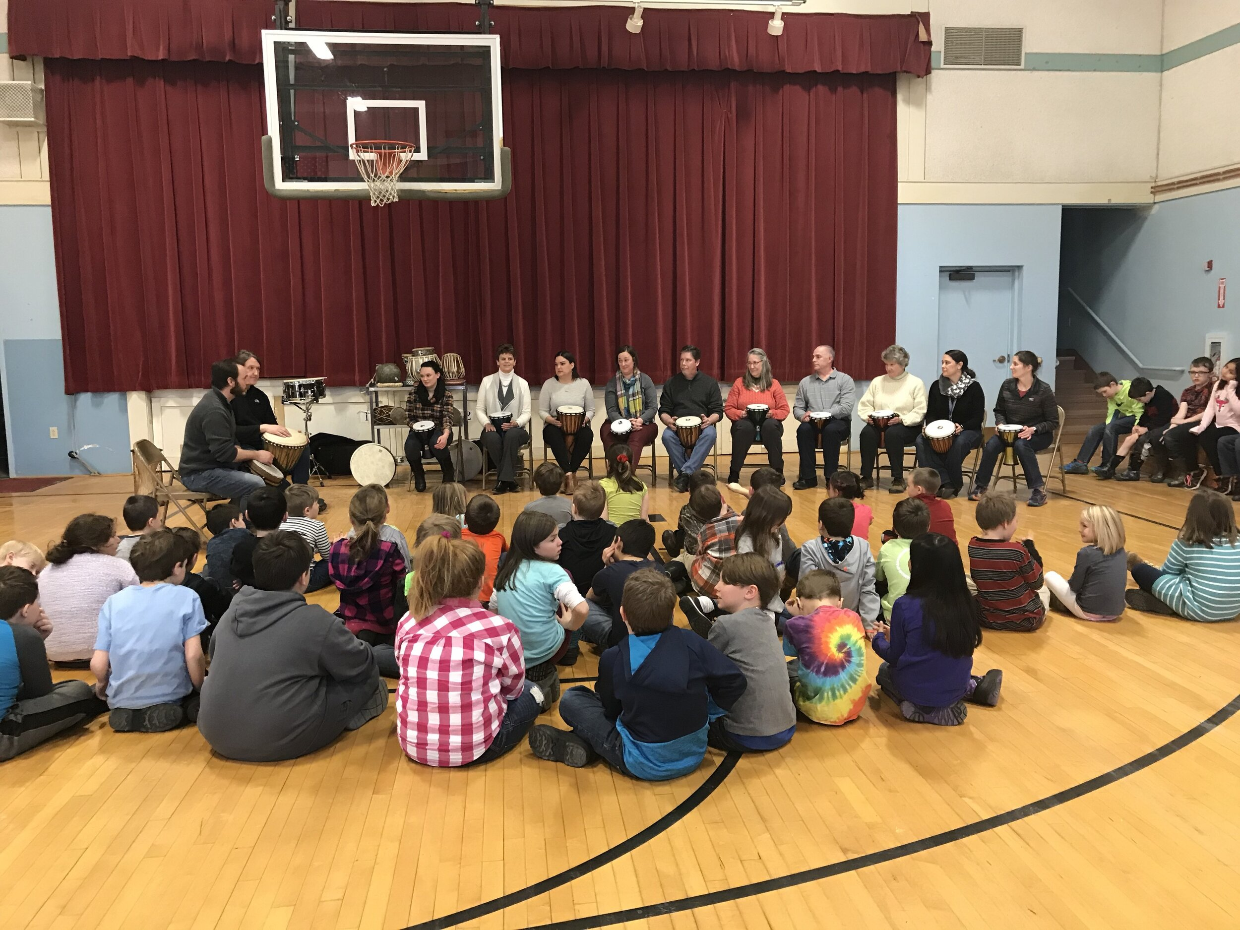 Tom Ulichny and Drew leading an interactive drum circle at a local elementary school.