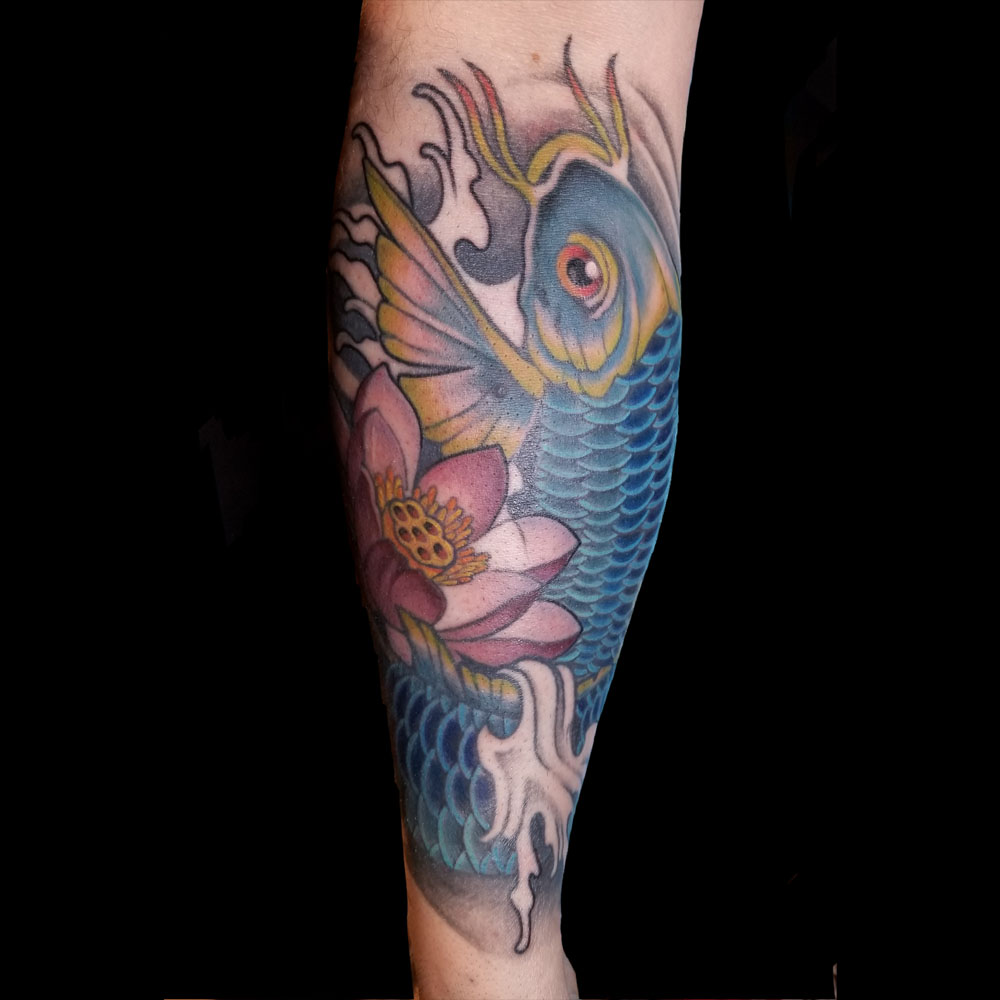 Kimi-Ledger-Sacred-Lotus-Tattoo-Koi.jpg