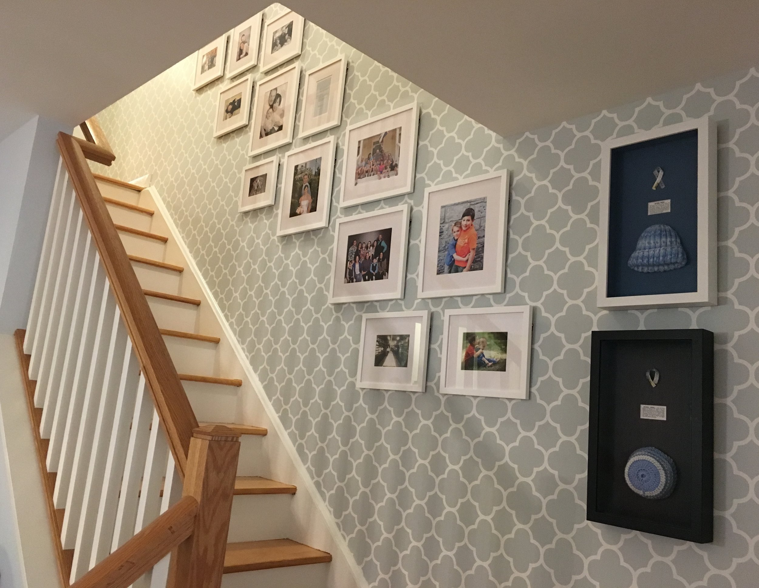 Framed family portraits going up the staircase