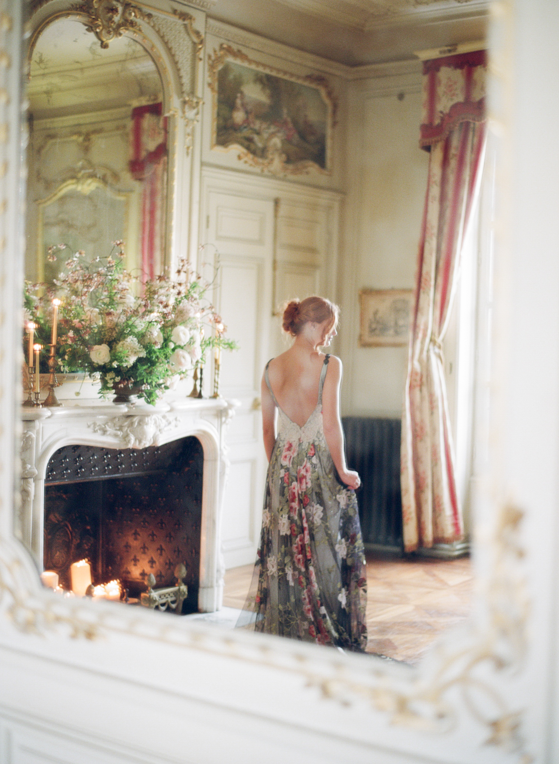 Bride's reflection in great hall mirror at Chateau de Varennes; Sylvie Gil Photography