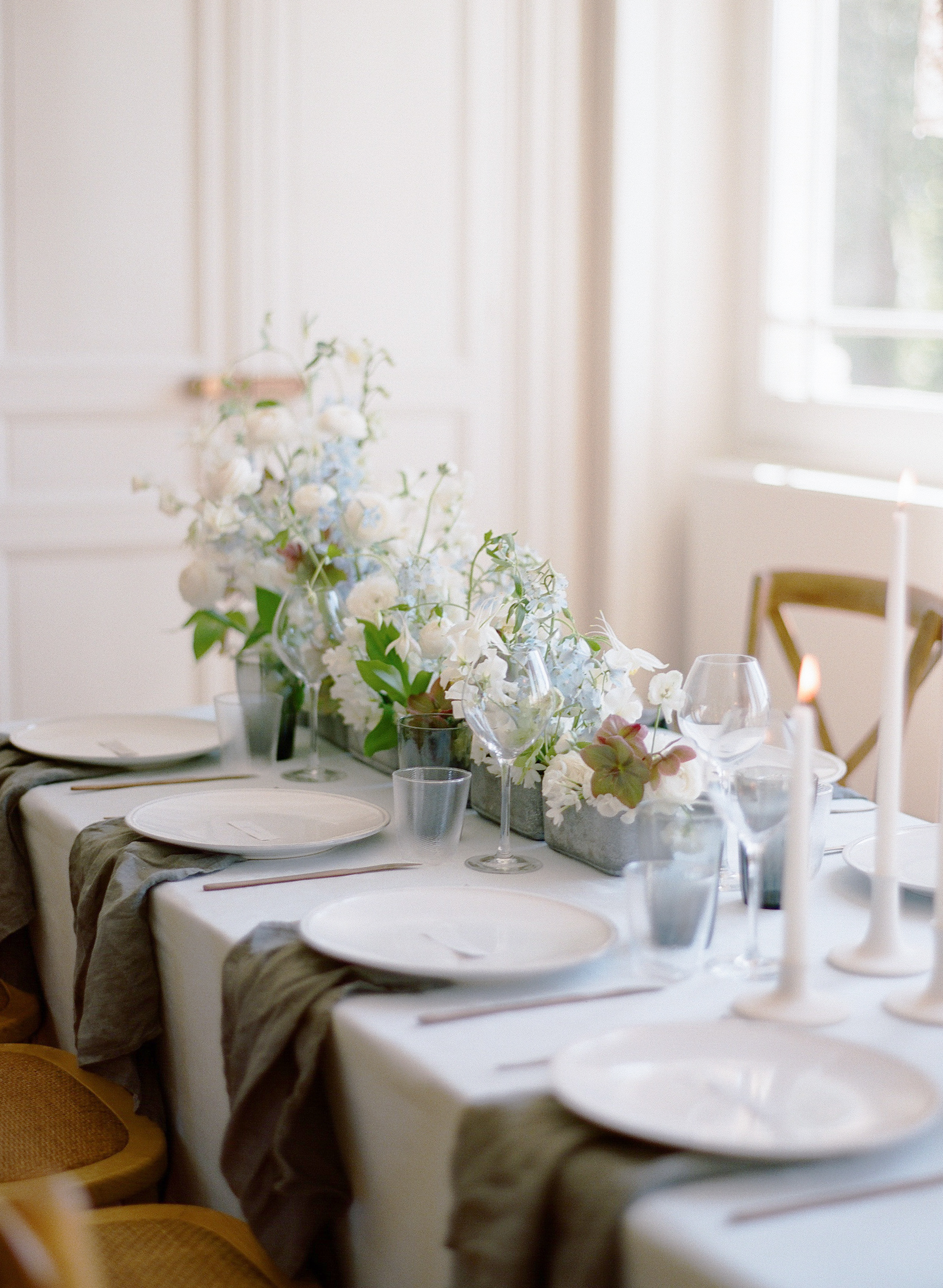 Styled reception table with concrete planters and simple linen napkins; Sylvie Gil Photography