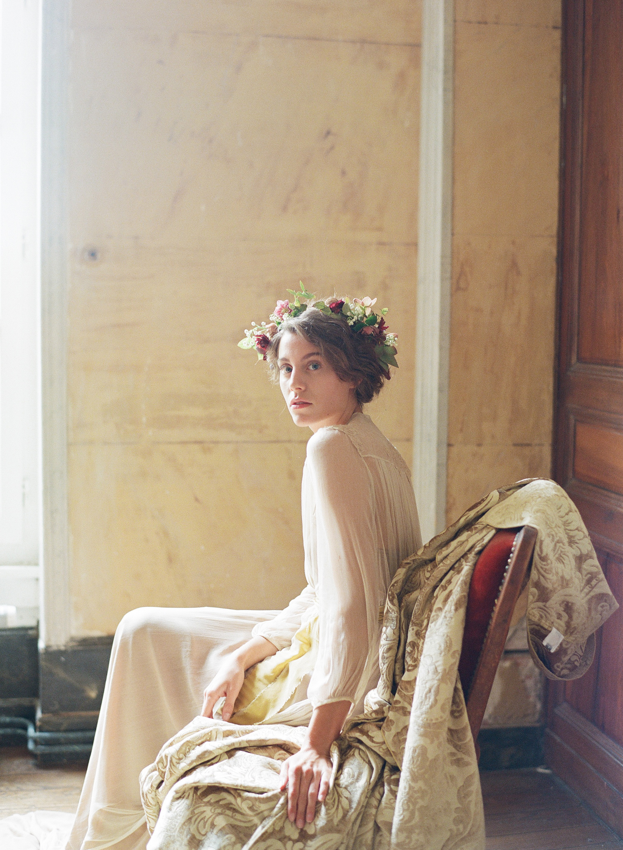 A Renaissance bride poses for a boudoir session in Chateau de Varennes; Sylvie Gil Photography
