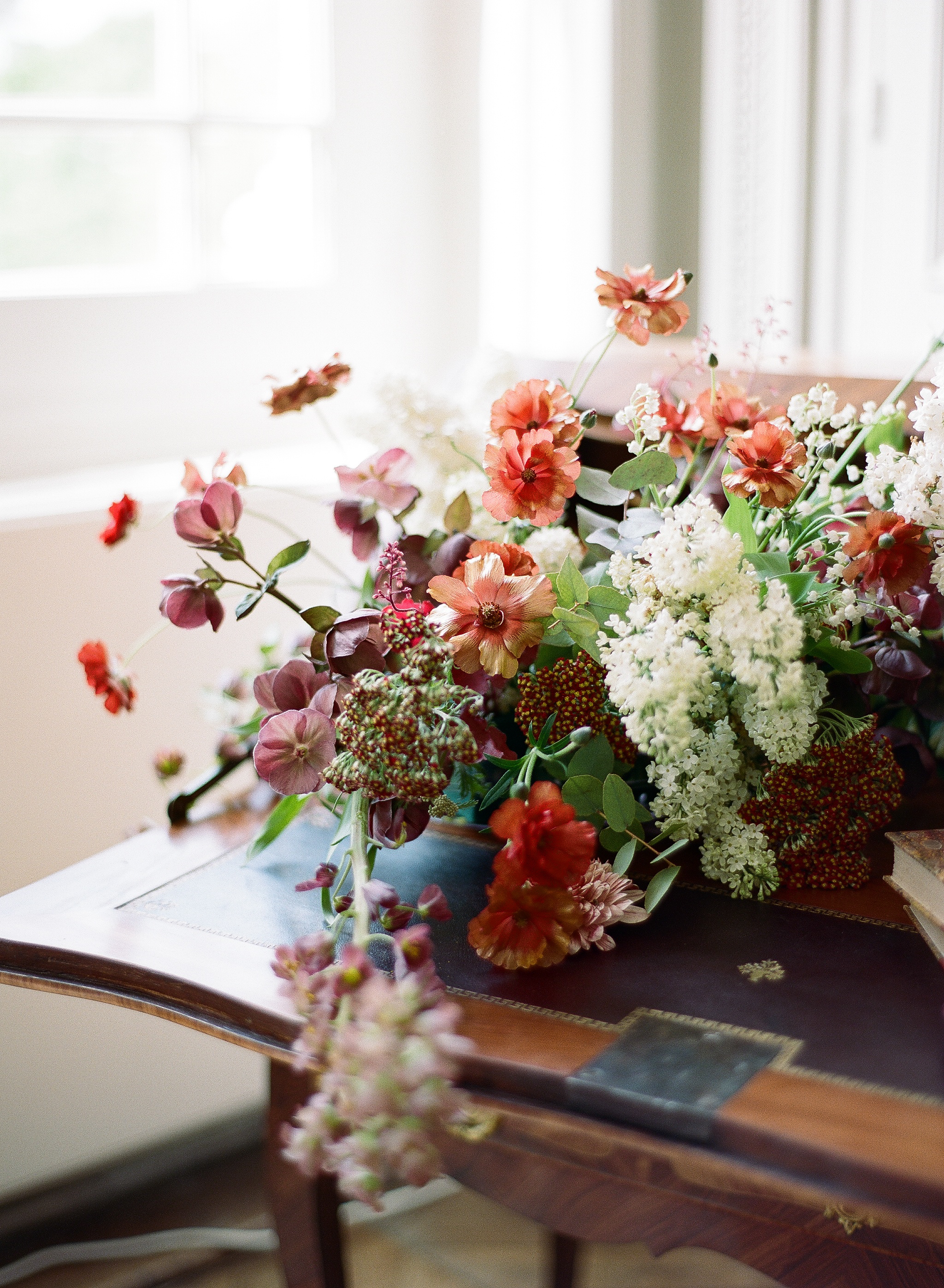 A mix of deep burgundy and sage green florals by Moon Canyon Design; Sylvie Gil Photography