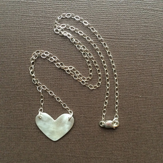 Darling Heart Necklaces by Rusty Chain Jewelry in sterling and copper are cut by hand out of sheet metal.