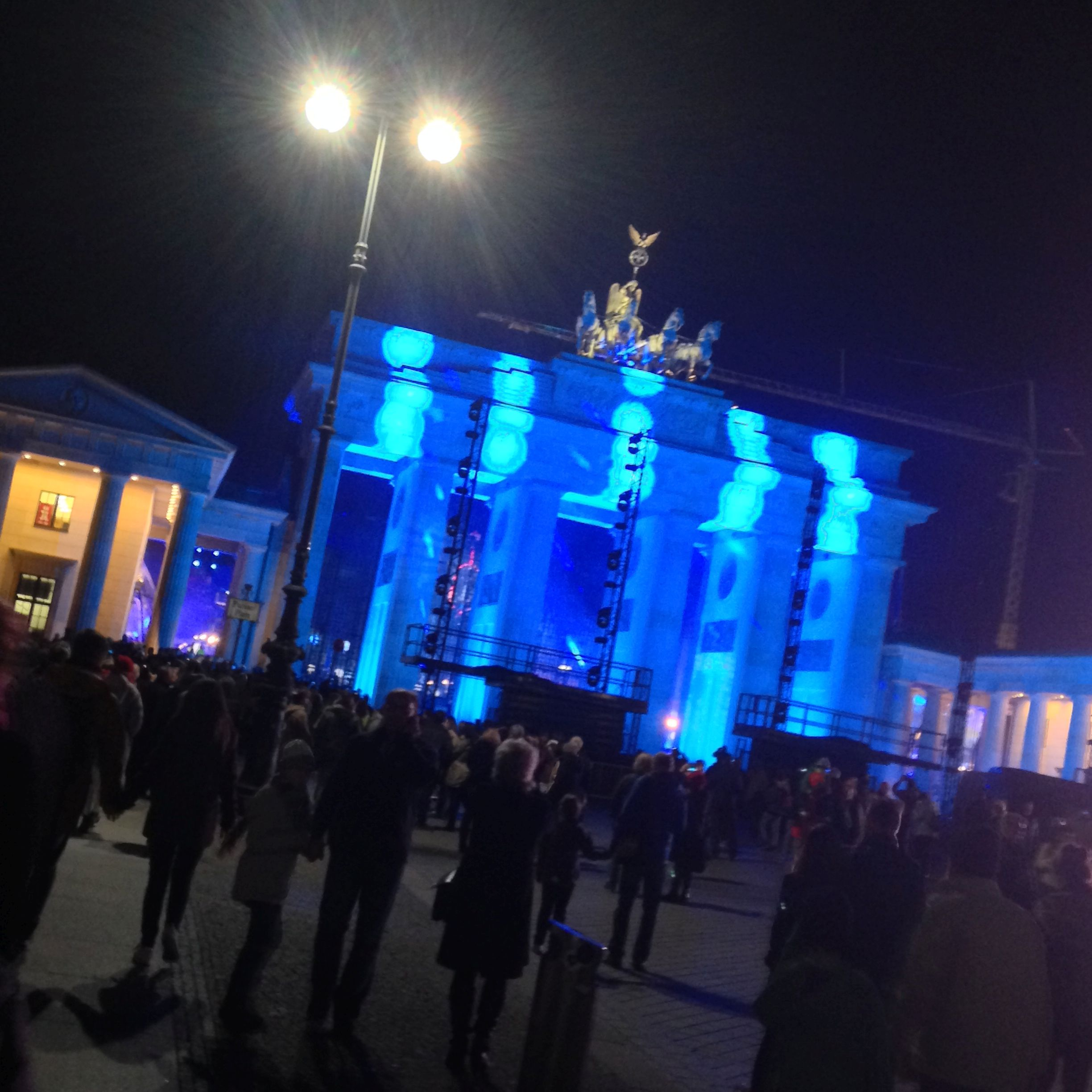 """People on Saturday Evening looking at the newly lightened """"Brandenburger Tor"""""""