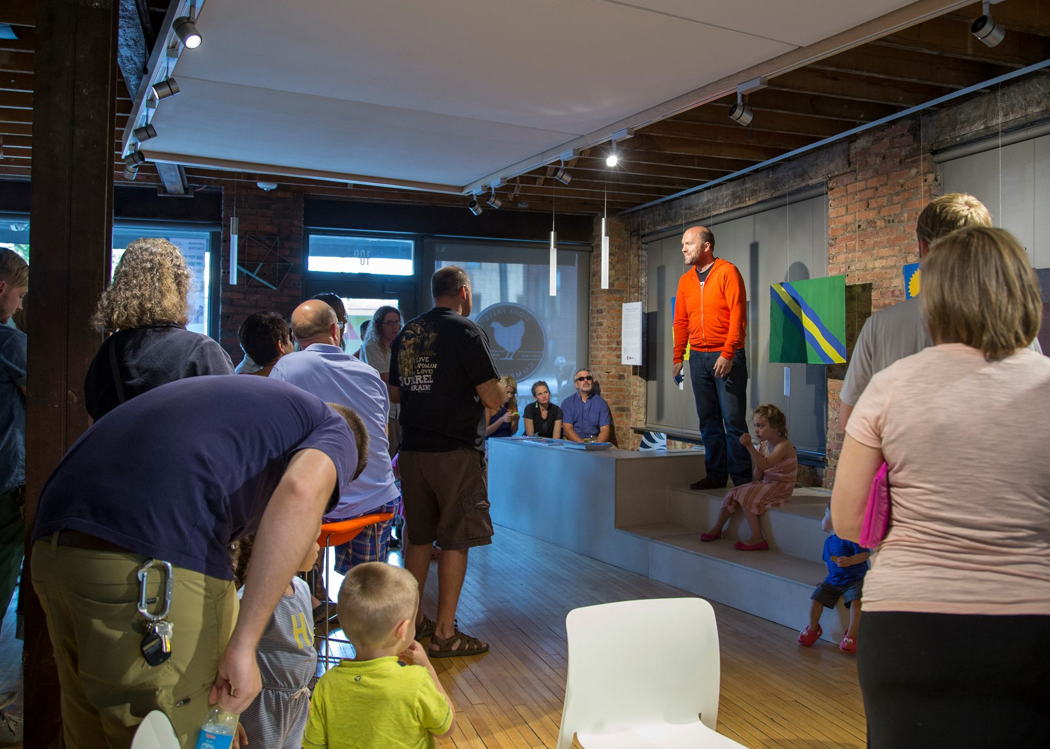 The Community of Sioux Falls reviews the Top 6 flags at the Sioux Falls Design Center gallery showing in August 2014.
