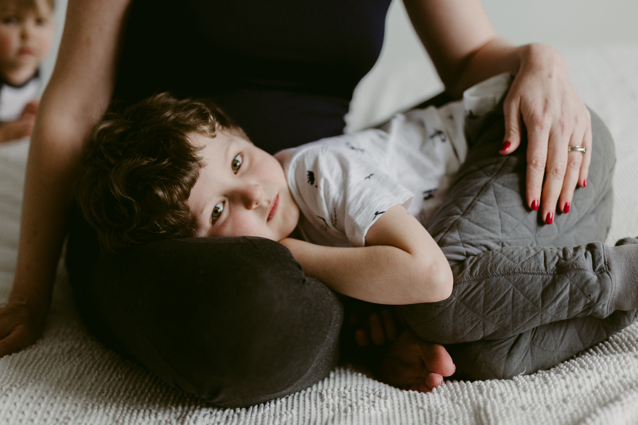 son in mom's lap