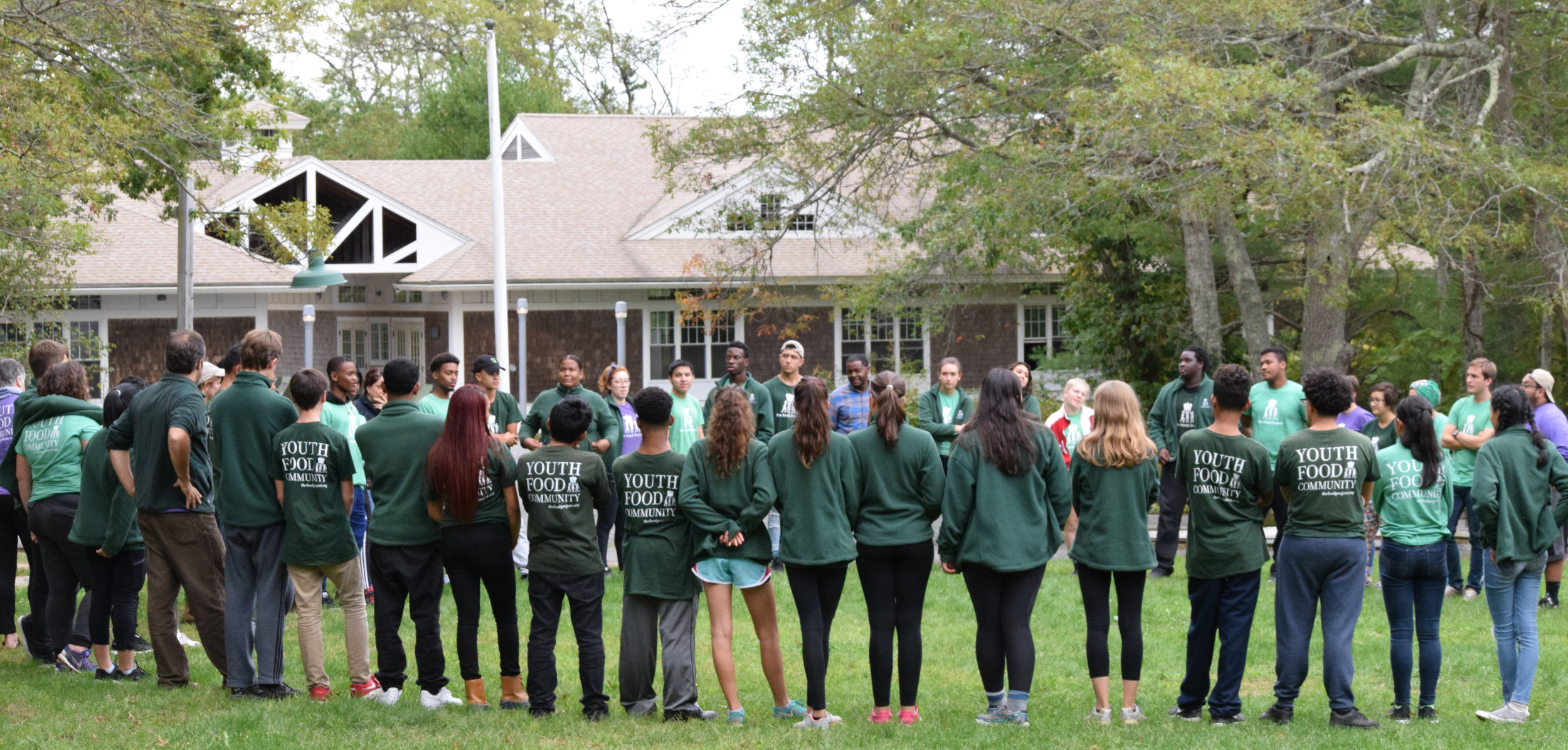 Seventy-five youth, staff, and alumni opening the first Lenore Travis Youth Retreat in 2016.
