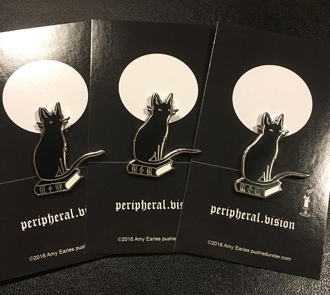 Peripheral.vision hard enamel pins by Amy Earles