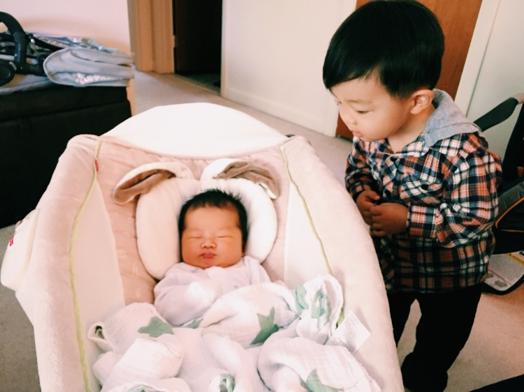 D meeting my friend's newborn and getting in some big brother practice!