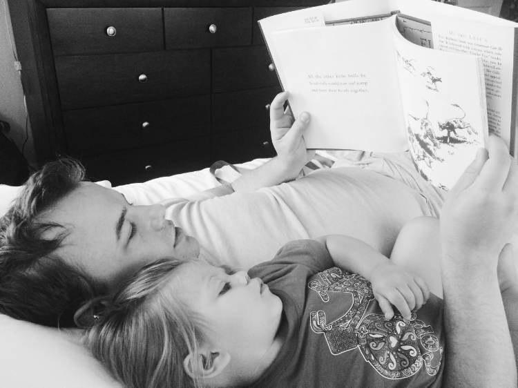 Gaby and daddy reading his new book on Father's Day 2015.