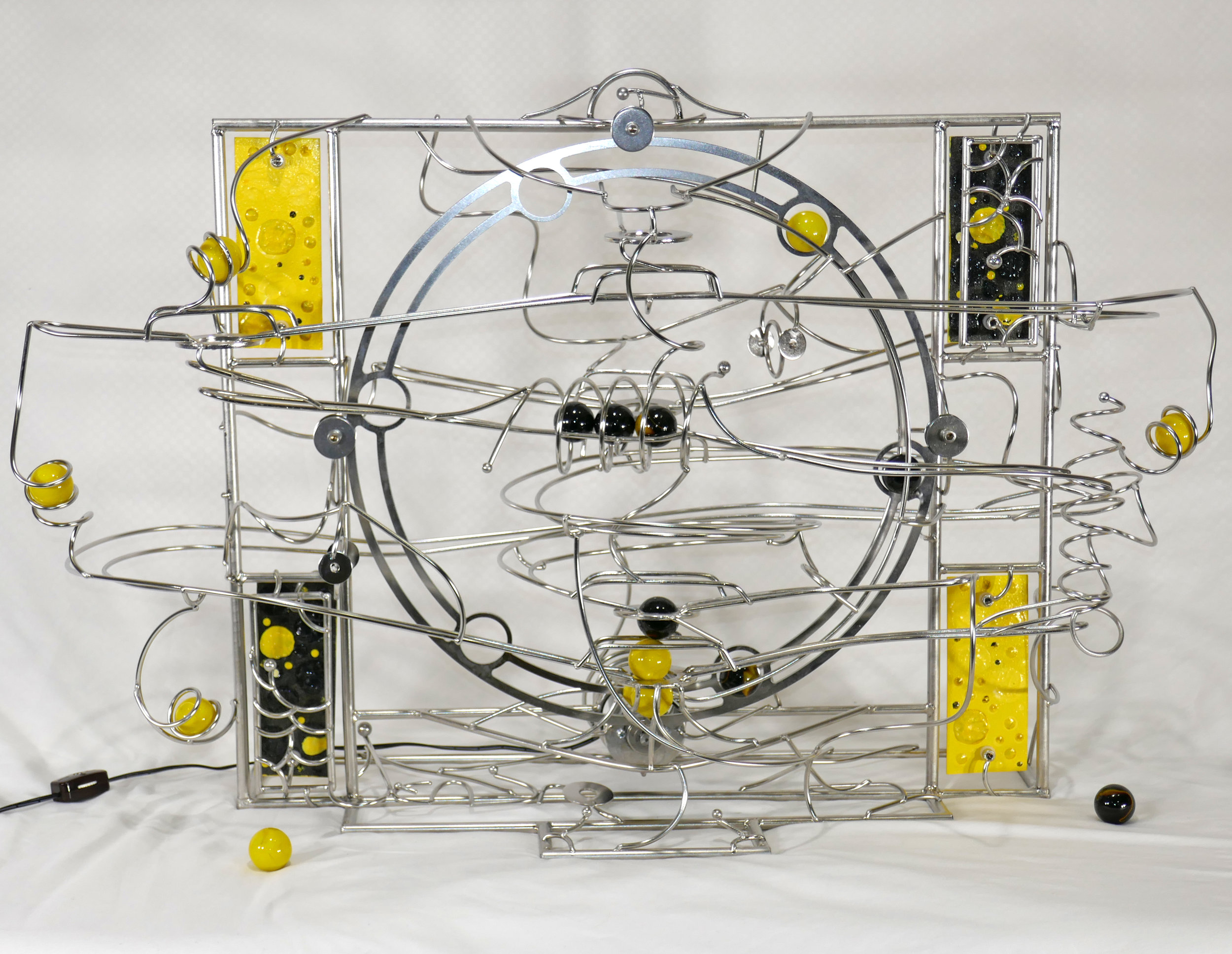 Rolling ball marble machine - Yellow and black marbles - named Orpiment - front view