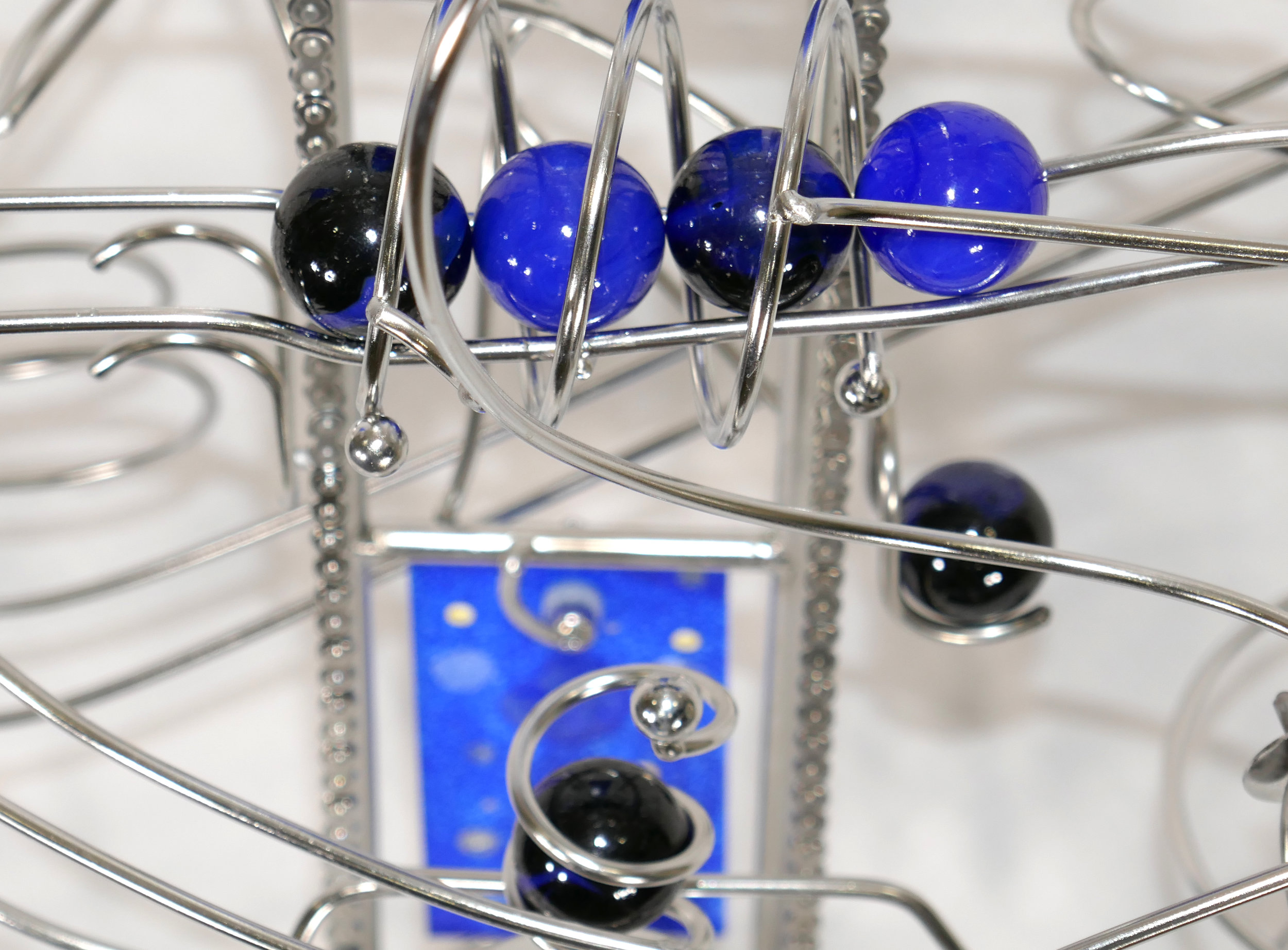 Rolling ball marble machine - close up of energy transfer kinetic element