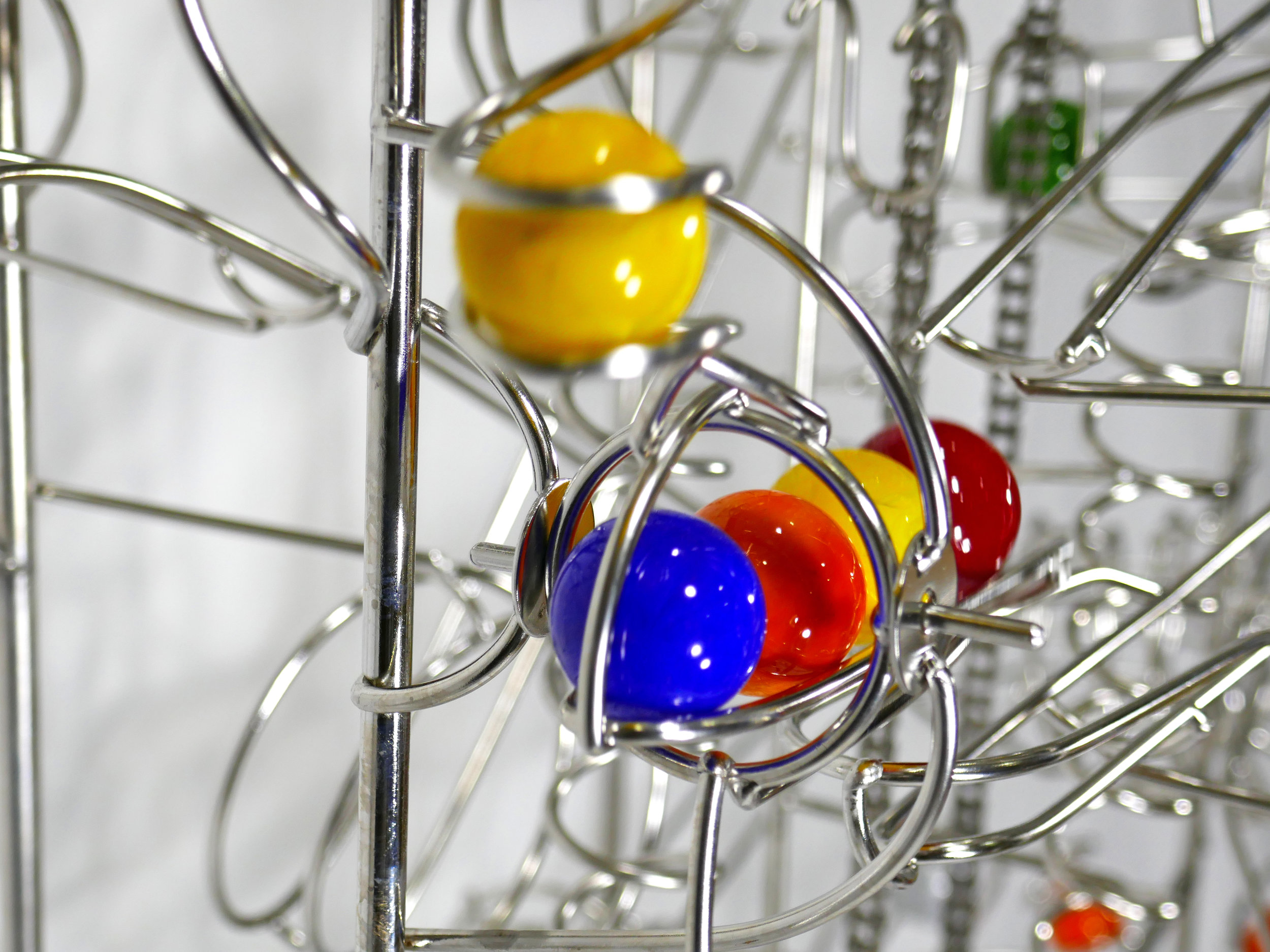 Rolling ball marble run sculptures - close up of ball drop kinetic element - Stephen Jendro