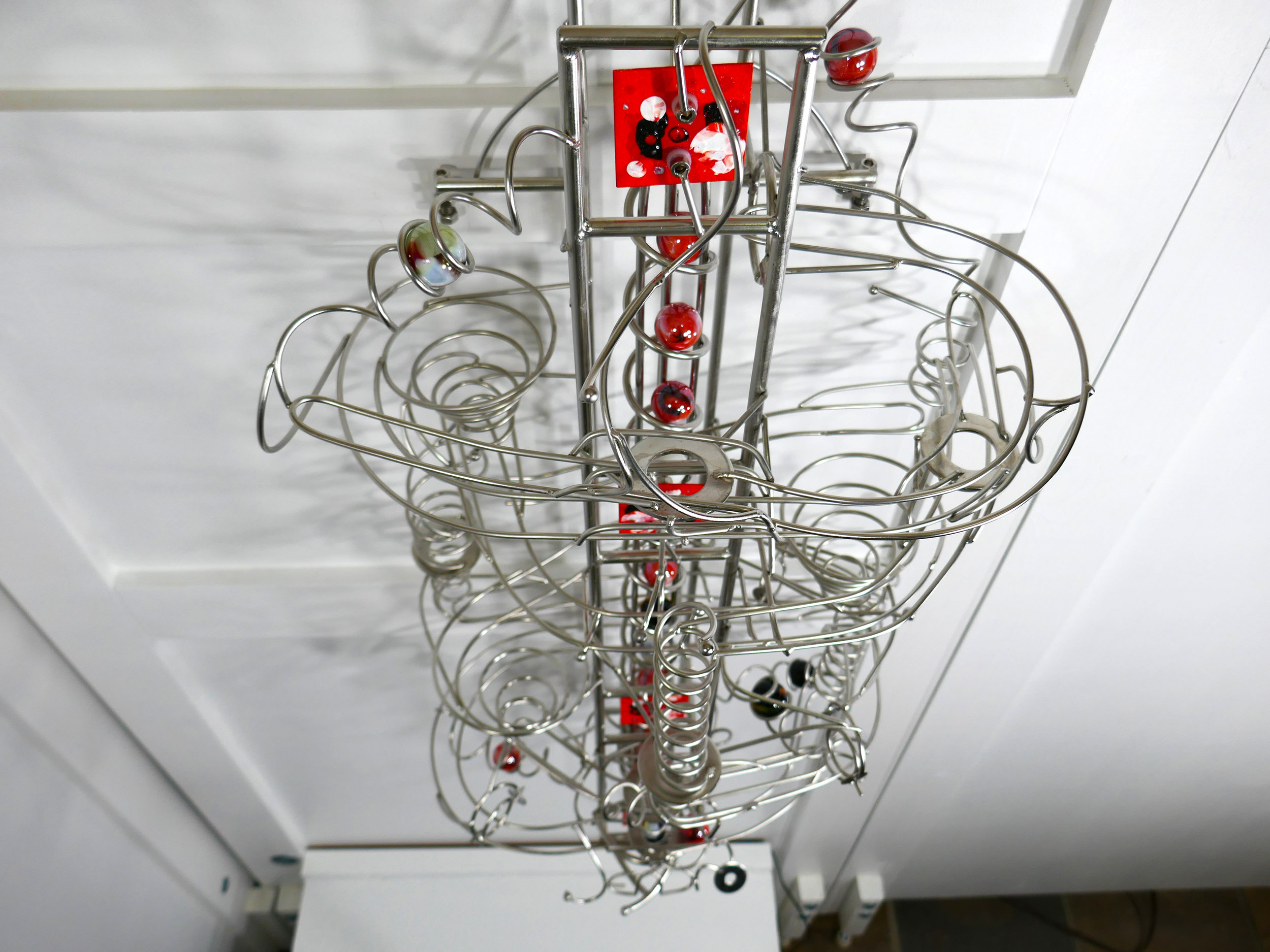 Marble run sculpture - kinetic art front view looking top down - Stephen Jendro