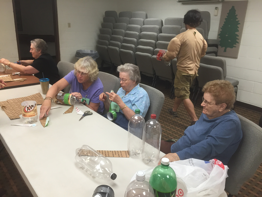 Retreat guests are busy building their water-bottle rockets.