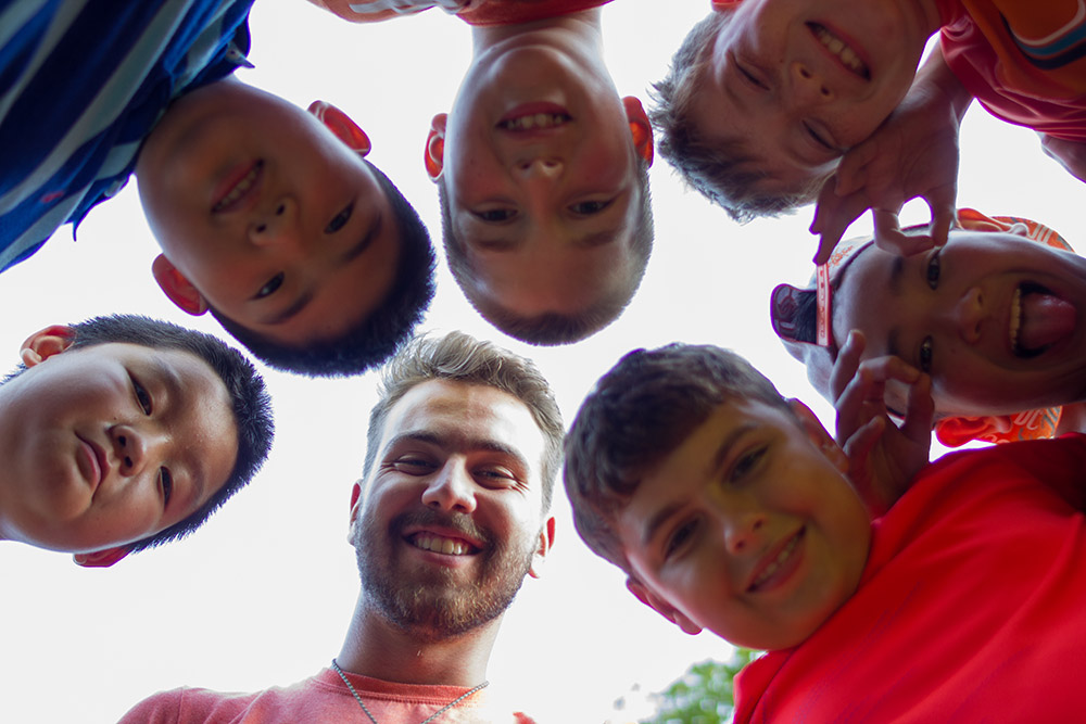 Summer staff help to facilitate community and experiential education