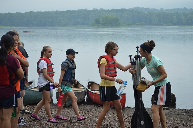 Paige, Jeana and the crew getting ready for a canoe trip.