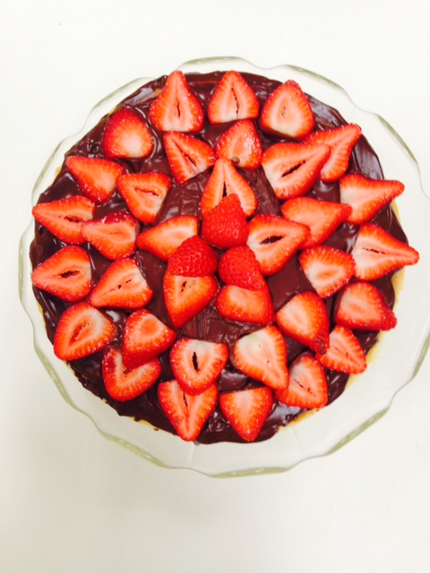 cheesecake with chocolate ganache and strawberries