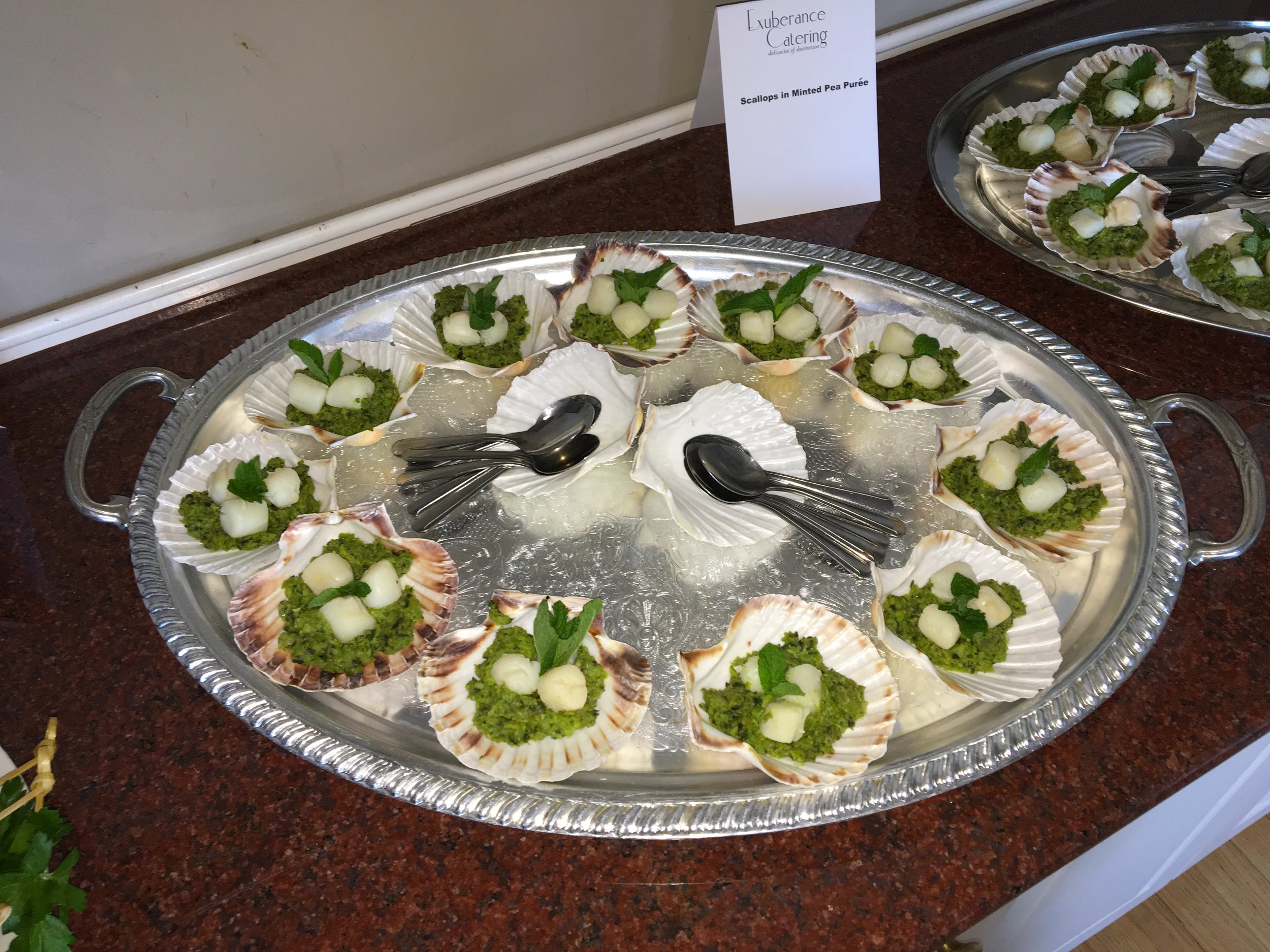 Scallops with minted pea puree in natural scallop shell