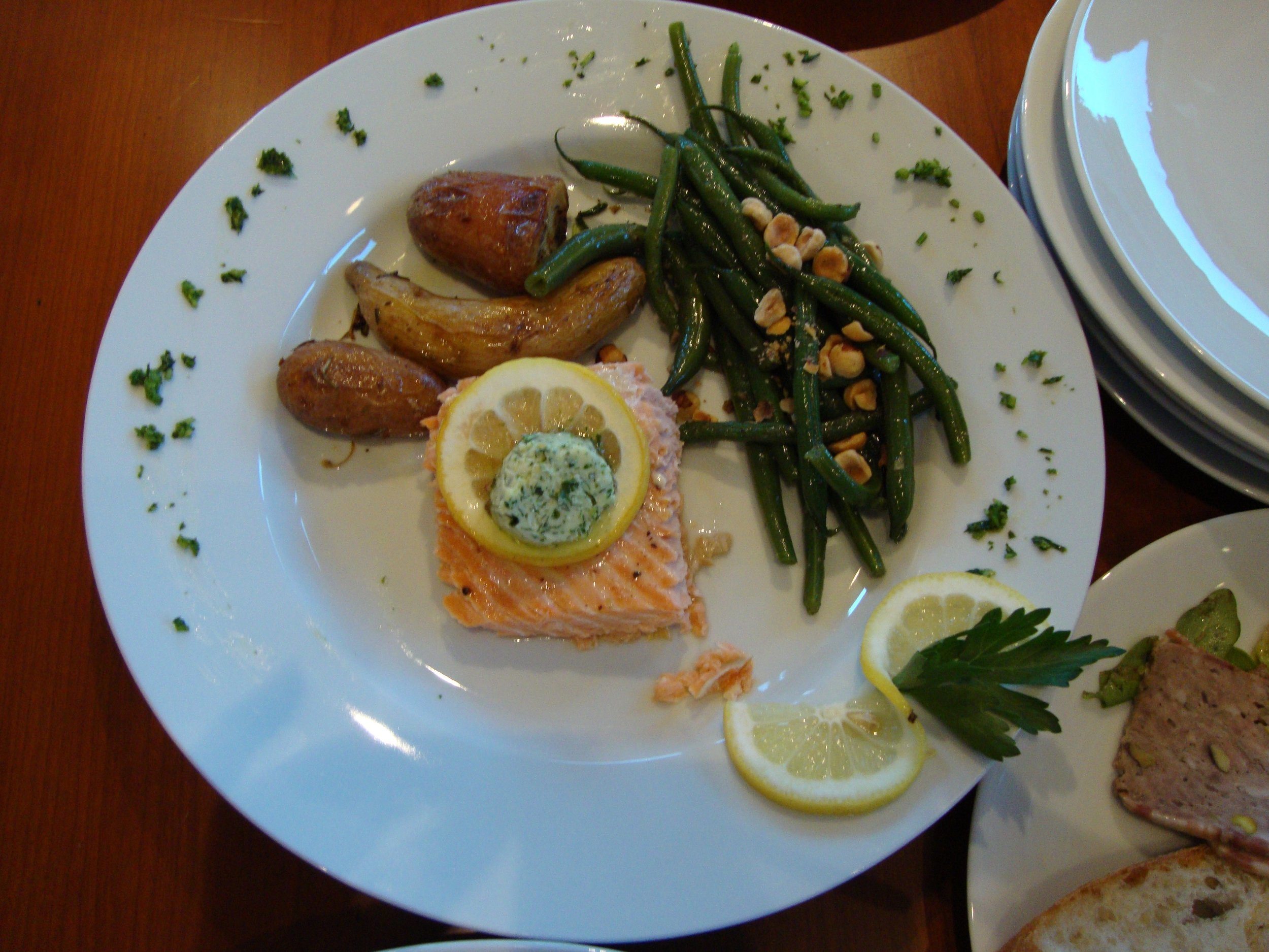 Dining Delivered. Salmon with herbed butter, fingerling potatoes, green beans with toasted hazelnuts.
