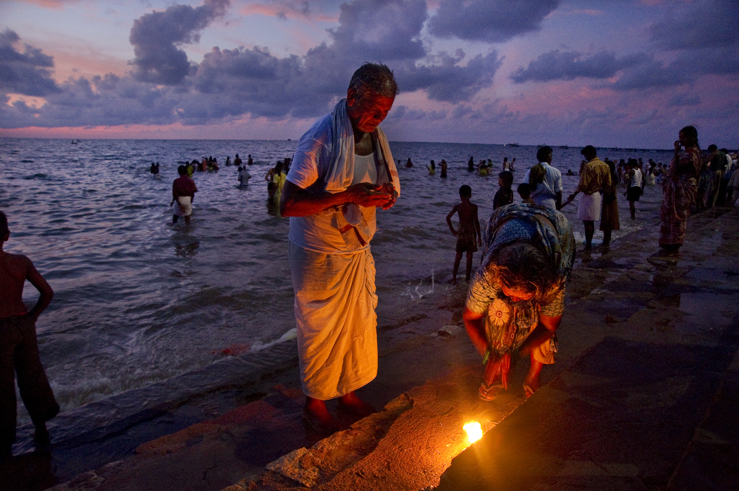 Hindu pilgrims making an offering outside Rameswaram's Ramanathaswamy temple, just before sunrise. Most Hindus believe that Hanuman and his army of monkeys built a bridge from this point in India to Sri Lanka to retrieve the kidnapped bride of Rama.